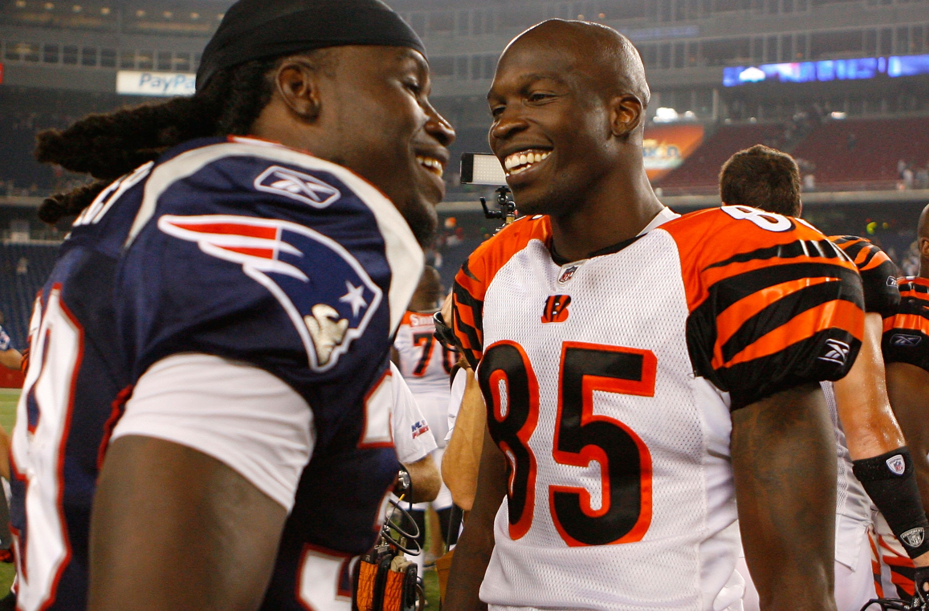 FOXBORO, MA - AUGUST 20:  Lawrence Maroney #39 of the New England Patriots chats with Chad Ochocinco #85 of the Cincinnati Bengals after a preseason game at Gillette Stadium on August 20, 2009 in Foxboro, Massachusetts. (Photo by Jim Rogash/Getty Images)
