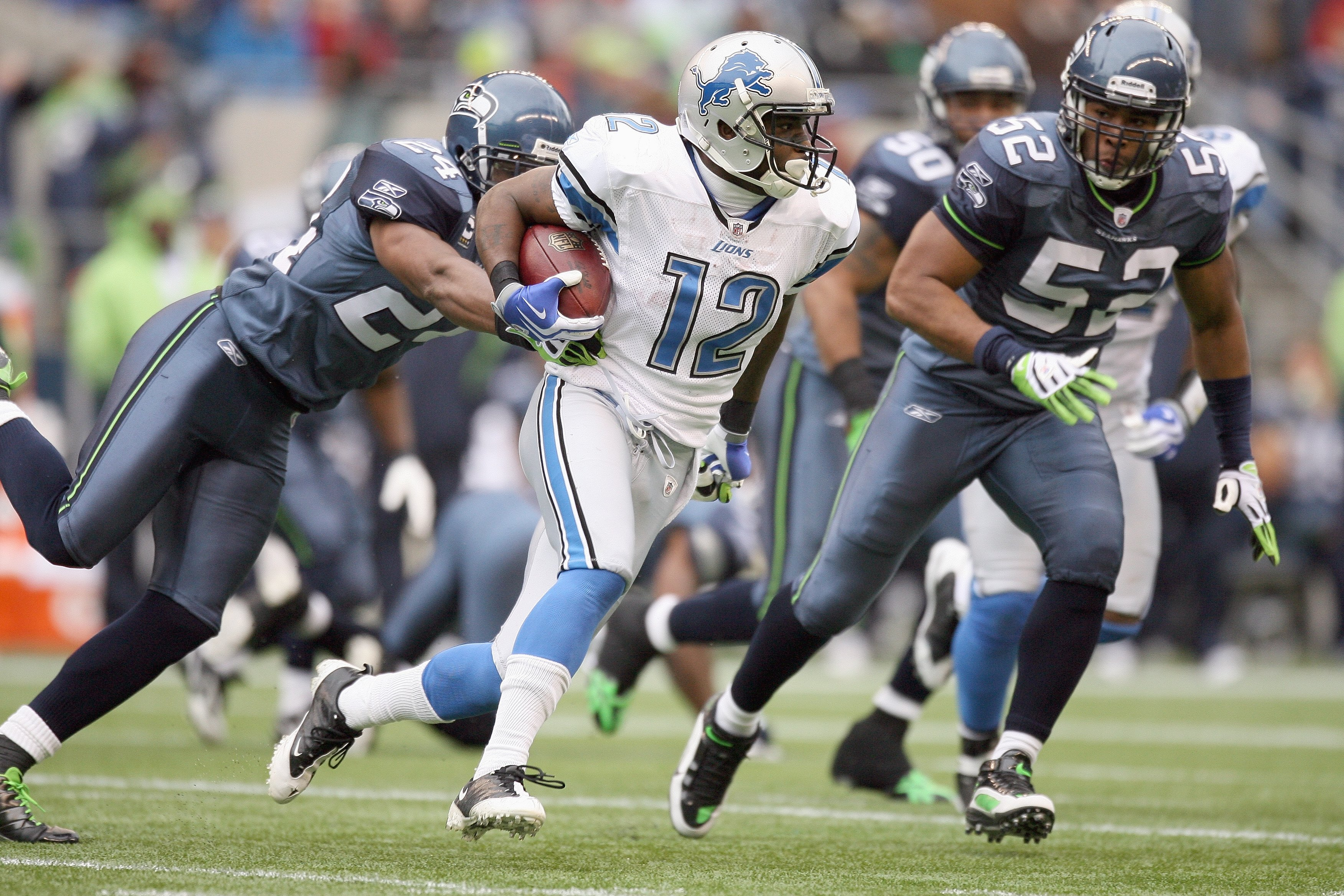 SEATTLE - NOVEMBER 08:  Derrick Williams #12 of the Detroit Lions carries the ball during the game against the Seattle Seahawks on November 8, 2009 at Qwest Field in Seattle, Washington. The Seahawks defeated the Lions 32-20. (Photo by Otto Greule Jr/Gett