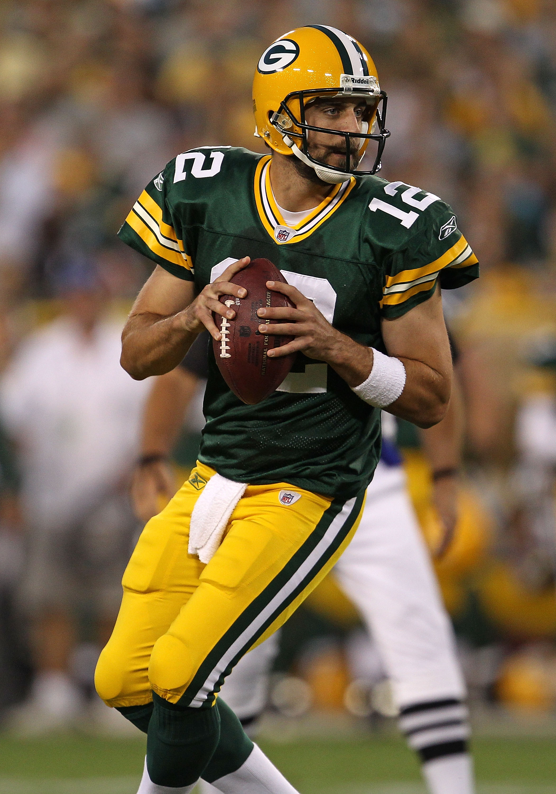 GREEN BAY, WI - AUGUST 26: Aaron Rodgers #12 of the Green Bay Packers looks for a receiver against the Indianapolis Colts during a preseason game at Lambeau Field on August 26, 2010 in Green Bay, Wisconsin. The Packers defeated the Colts 59-24.  (Photo by