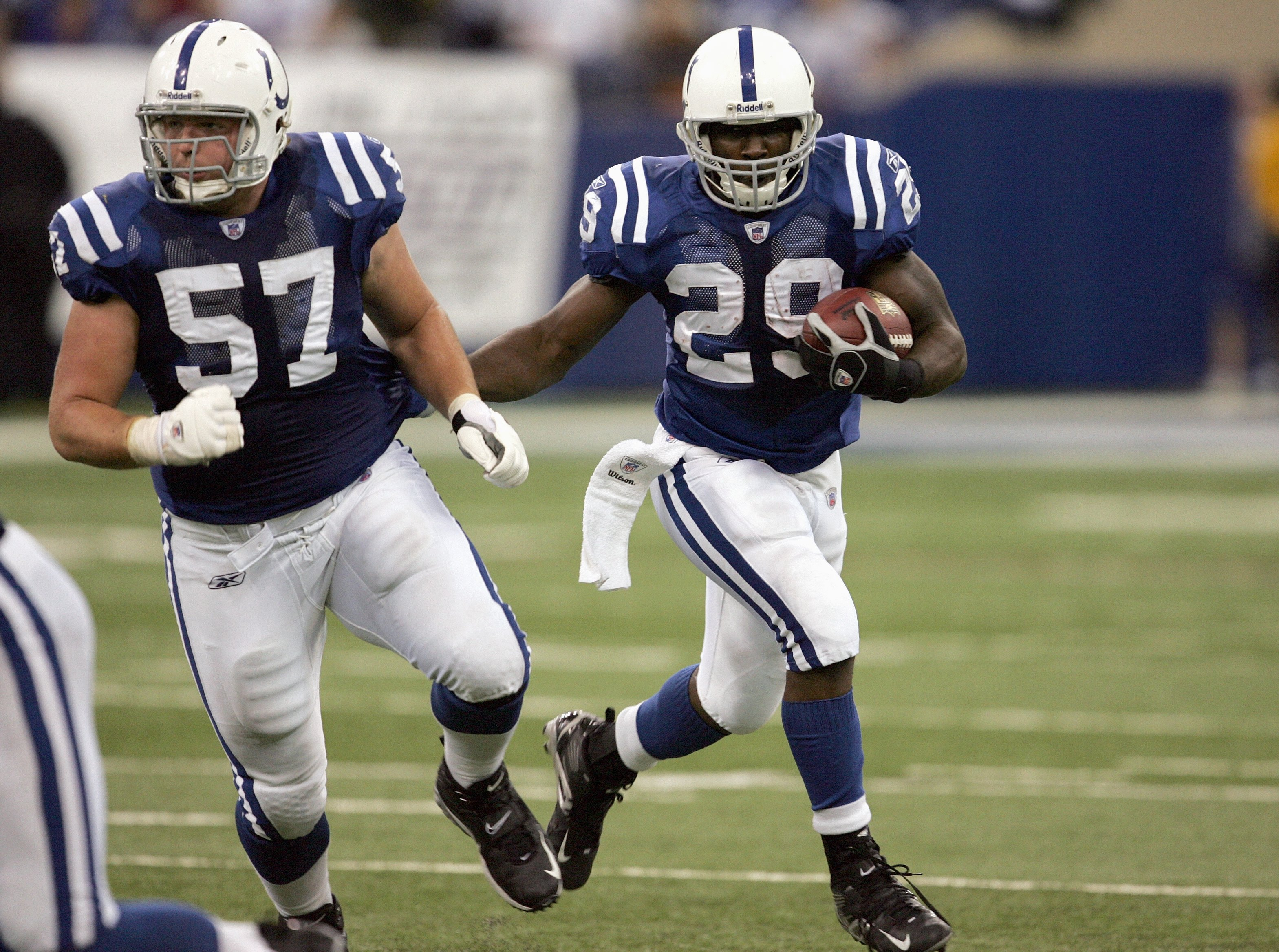 INDIANAPOLIS - NOVEMBER 12:  Joseph Addai #29 of the Indianapolis Colts carries the ball with Dylan Gandy #57 during the game against the Buffalo Bills on November 12, 2006 at the RCA Dome in Indianapolis, Indiana. The Colts defeated the Bills 17-16. (Pho