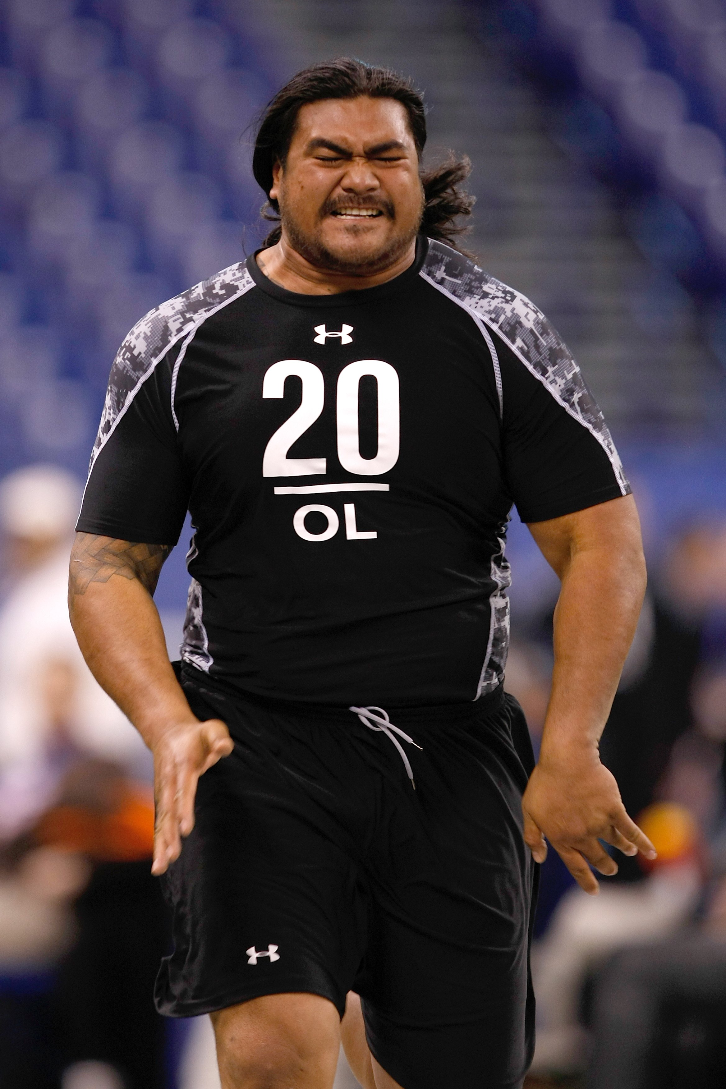 INDIANAPOLIS, IN - FEBRUARY 27: Offensive lineman Mike Iupati of Idaho runs the 40 yard dash during the NFL Scouting Combine presented by Under Armour at Lucas Oil Stadium on February 27, 2010 in Indianapolis, Indiana. (Photo by Scott Boehm/Getty Images)
