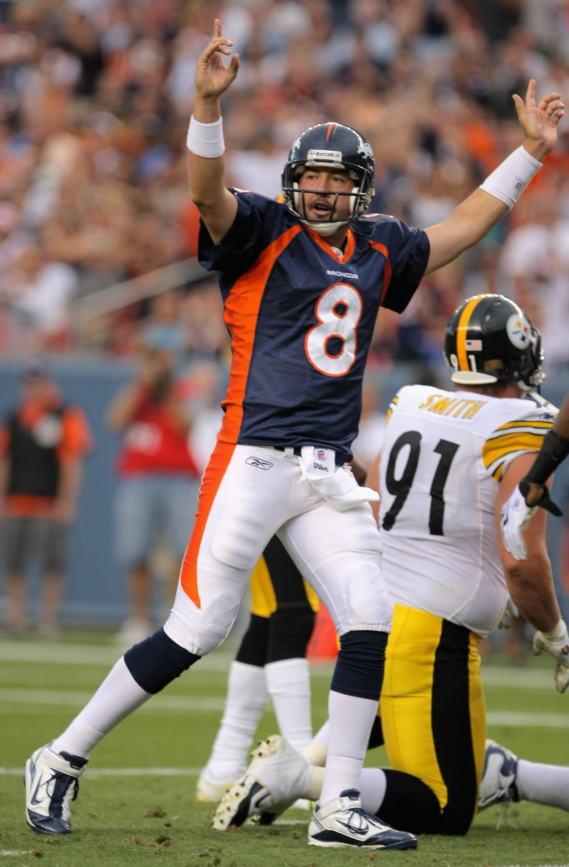 DENVER - AUGUST 29:  Quarterback Kyle Orton #8 of the Denver Broncos celebrates a touchdown by teammate LenDale White in the first quarter against the Pittsburgh Steelers during preseason NFL action at INVESCO Field at Mile High on August 29, 2010 in Denv