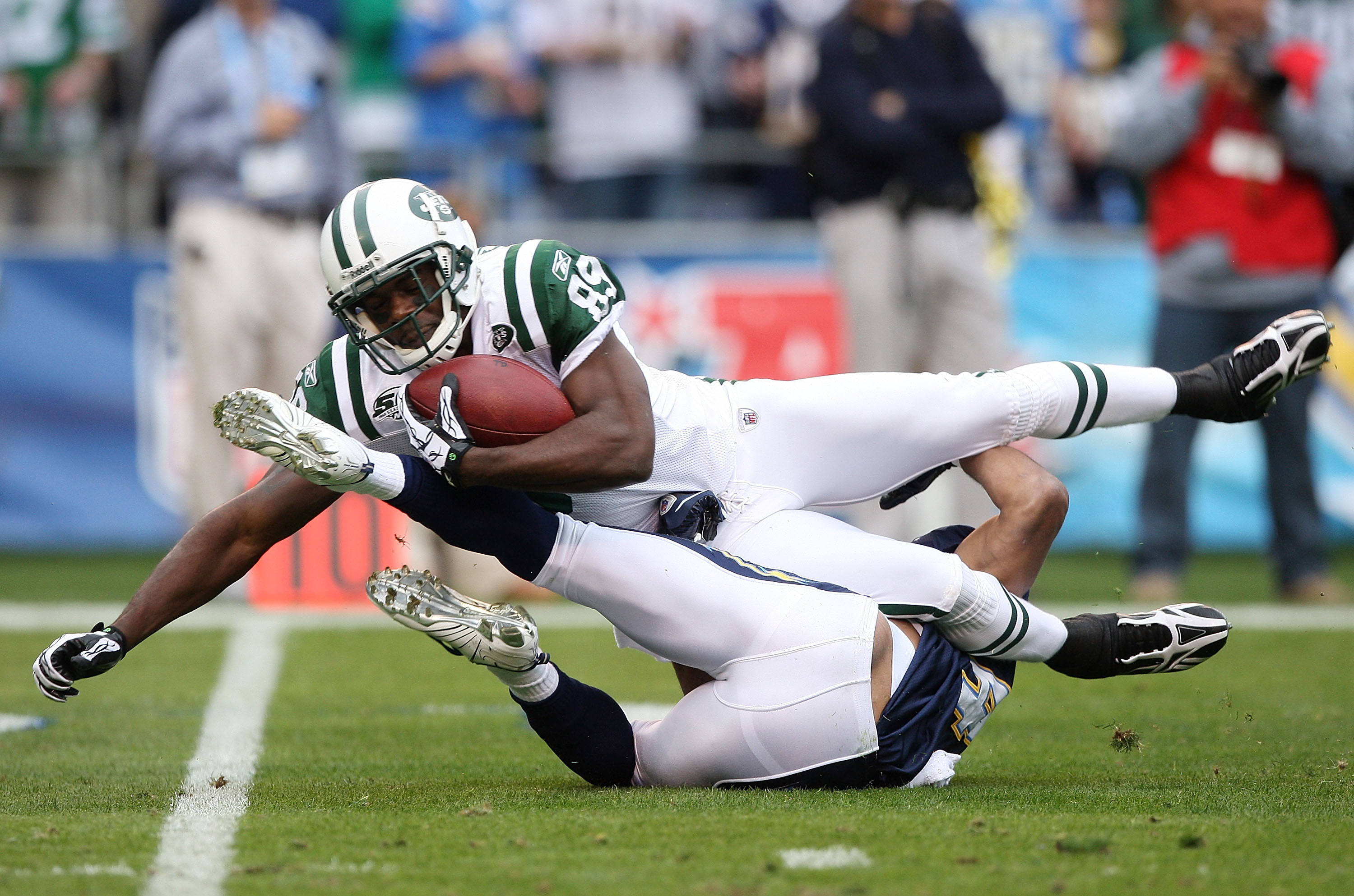 SAN DIEGO - JANUARY 17:  Wide receiver Jerricho Cotchery #89 of the New York Jets is tackled after making a catch against the San Diego Chargers during the AFC Divisional Playoff Game at Qualcomm Stadium on January 17, 2010 in San Diego, California.  (Pho