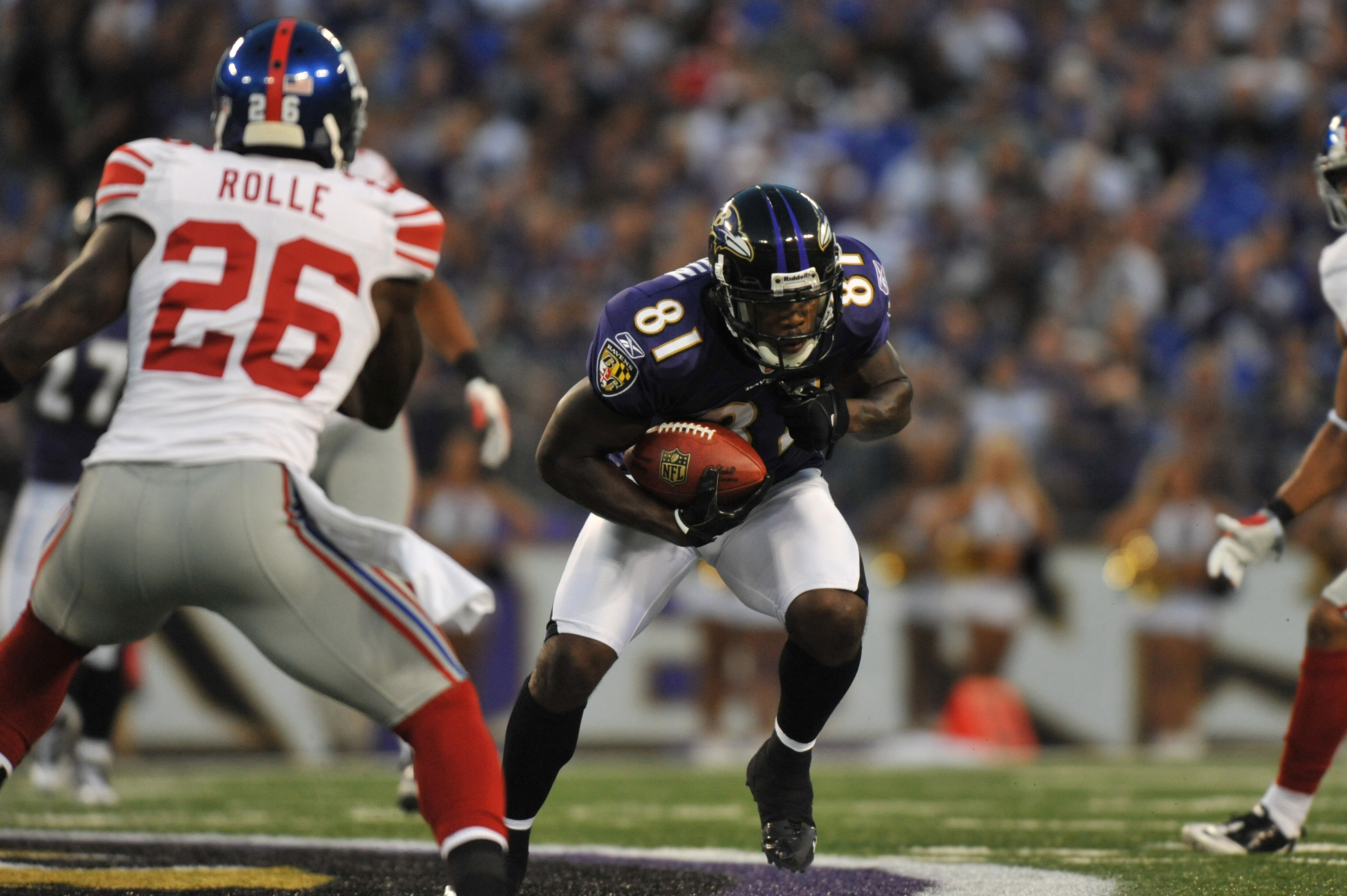 BALTIMORE - AUGUST 28:  Anquan Boldin #81 of the Baltimore Ravens makes a catch during the game against the New York Giants at M&T Bank Stadium on August 28, 2010 in Baltimore, Maryland. The Ravens lead the Giants 17-3. (Photo by Larry French/Getty Images