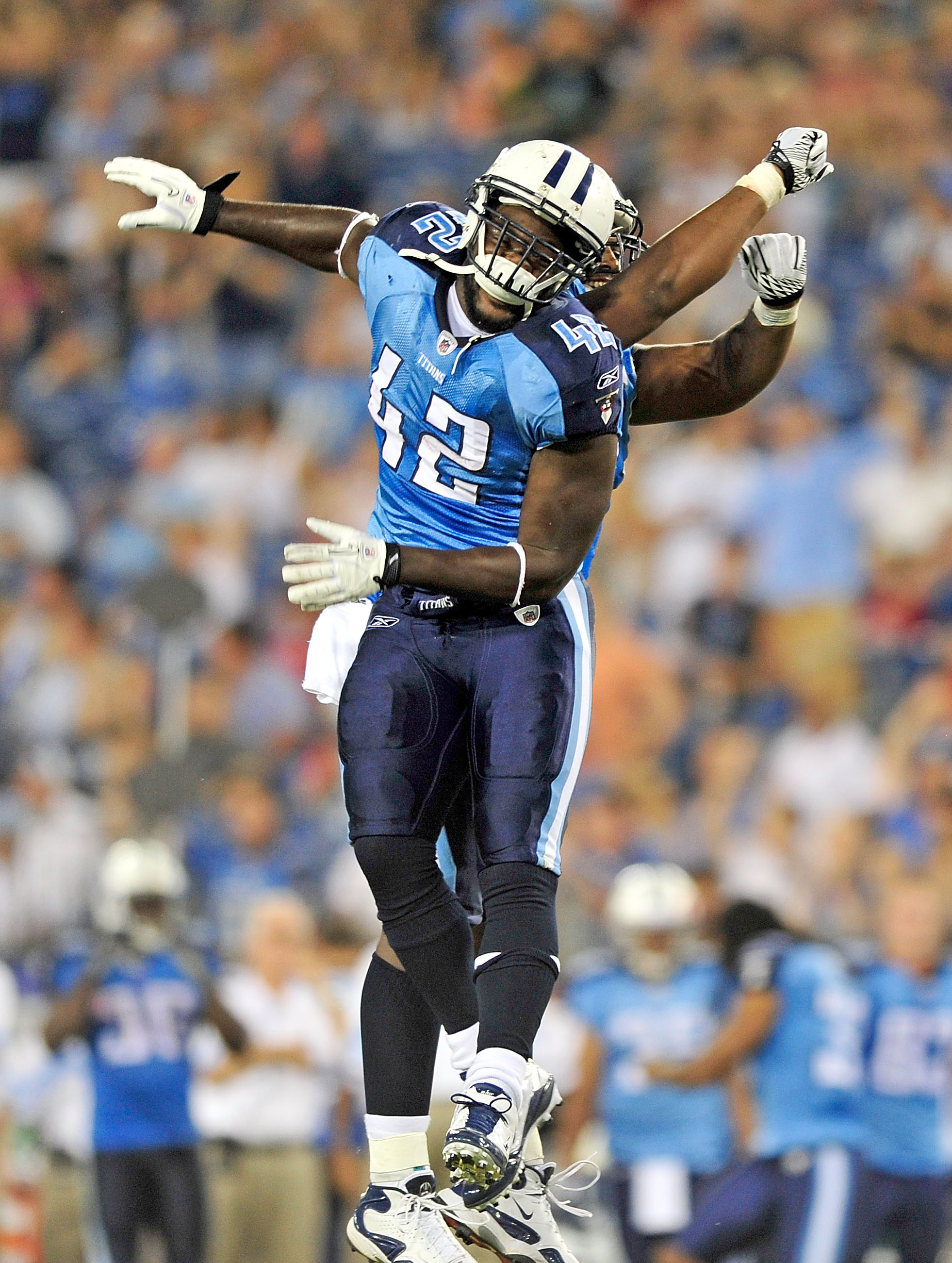 NASHVILLE, TN - SEPTEMBER 02:  LeGarrette Blount #42 of the Tennessee Titans celebrates with teammate Fernando Velasco #61 after scoring a touchdown against the New Orleans Saints during an exhibition game at LP Field on September 2, 2010 in Nashville, Te