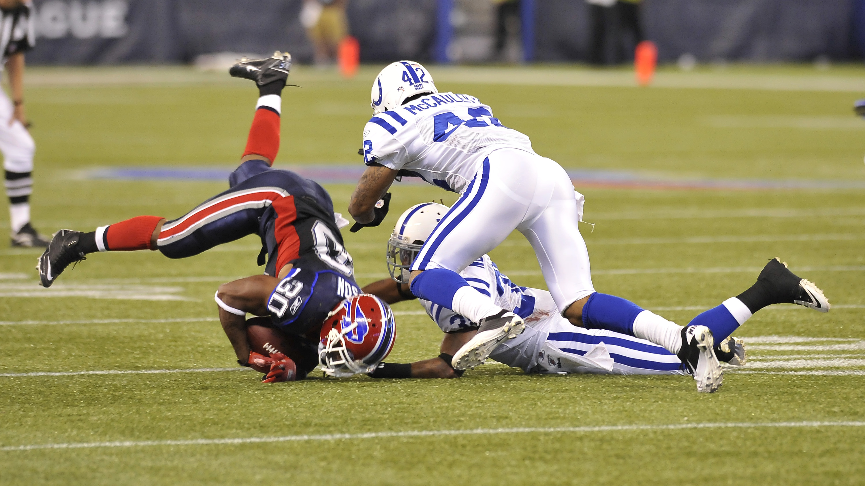 TORONTO - AUGUST 19:  Chad Simpson #30 of the Buffalo Bills is takled by Marcus McCauley #42 and Mike Newton #38 of the Indianapolis Colts during game action August 19, 2010 at the Rogers Centre in Toronto, Ontario, Canada. (Photo by Brad White/Getty Imag