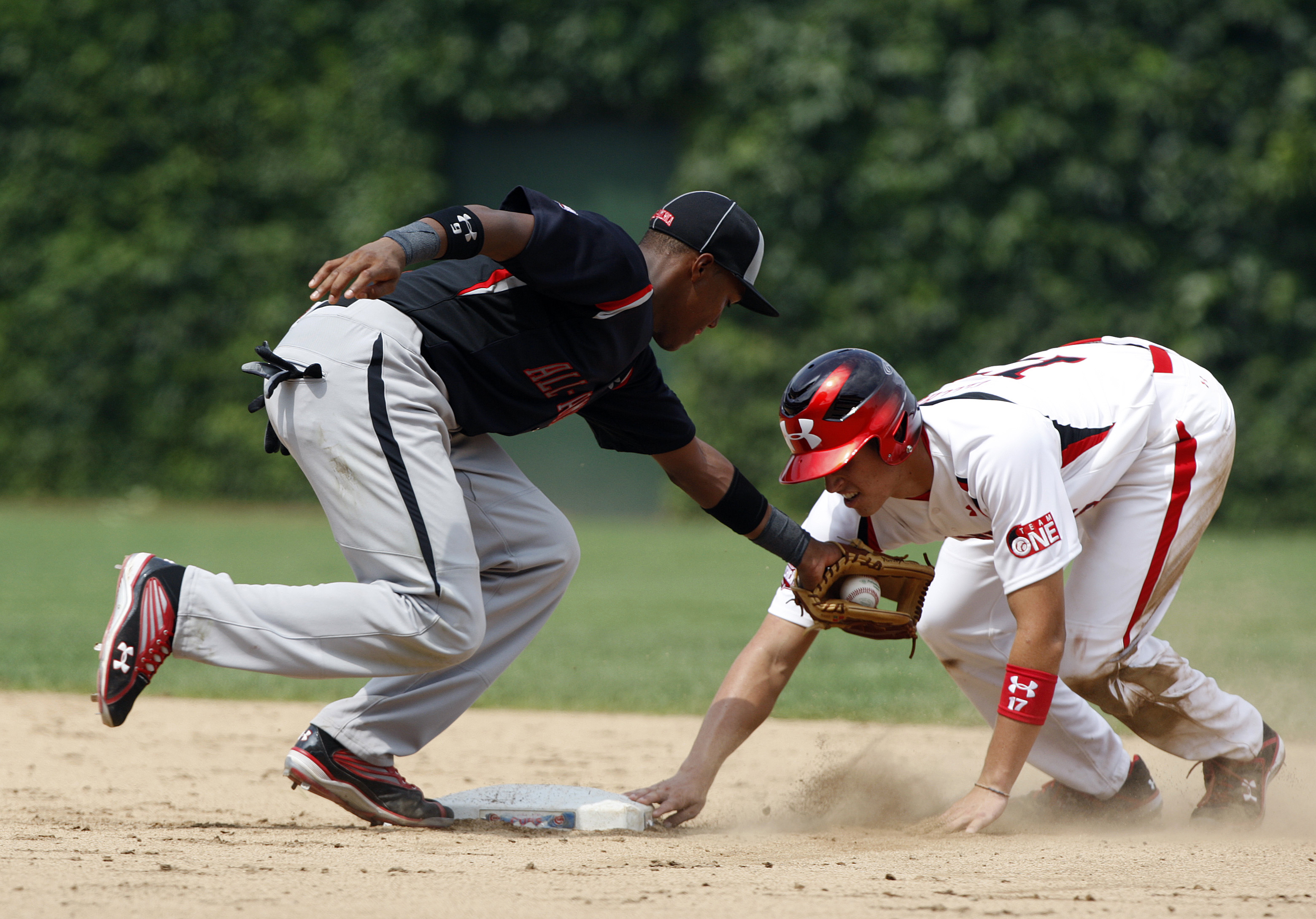 CHICAGO - AUGUST 8:  Yordy Cabrera of the Baseball Factory is late with the tag on Garin Cecchini of Team One after Garin stole second base during the Under Armour All-American Baseball game at Wrigley Field on August 8, 2009 in Chicago, Illinois.  (Photo