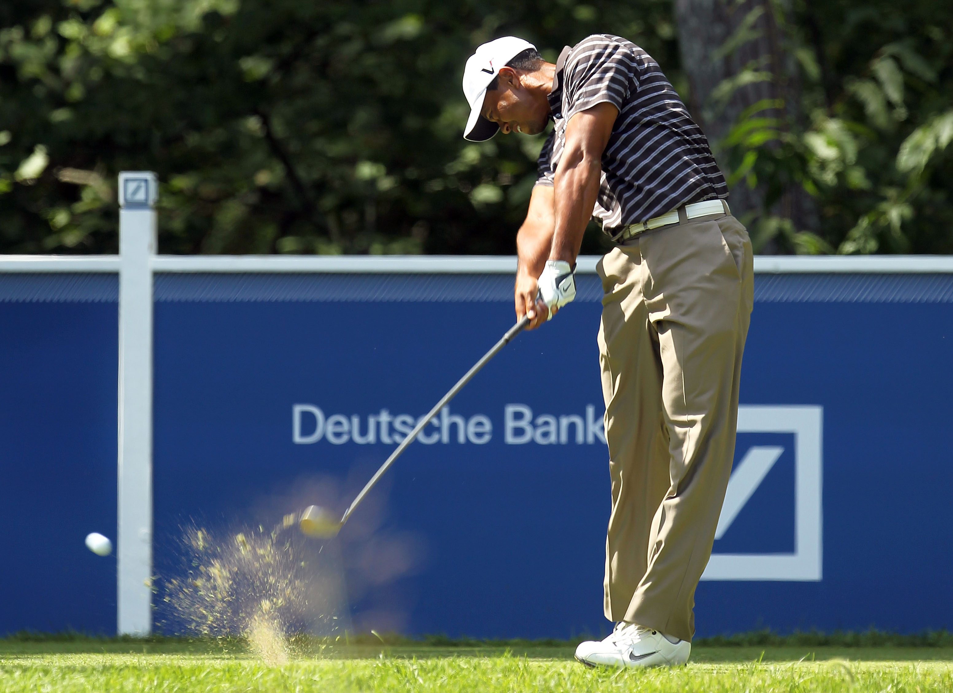 NORTON, MA - SEPTEMBER 05:  Tiger Woods tees off on the fourth hole during the third round of the Deutsche Bank Championship at TPC Boston on September 5, 2010 in Norton, Massachusetts.  (Photo by Mike Ehrmann/Getty Images)