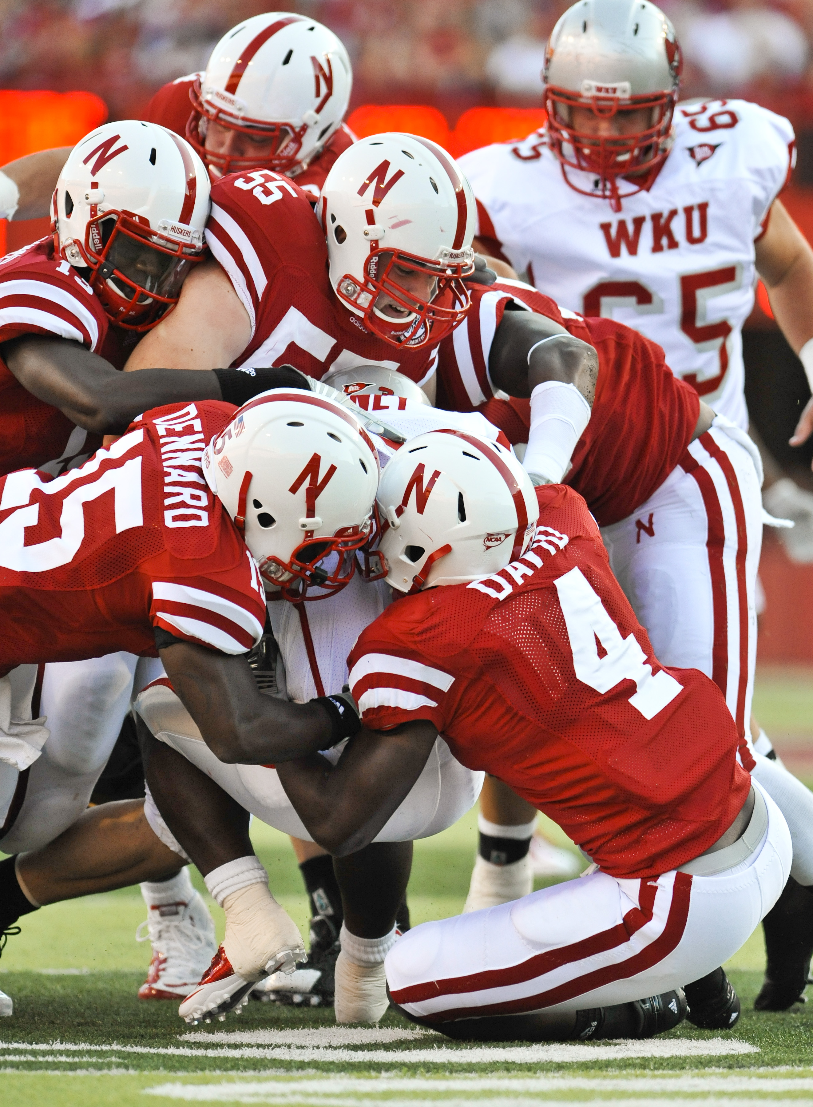LINCOLN, NE - SEPTEMBER 04:  The Nebraska Cornhuskers  defense swarms Bobby Rainey of the Western Kentucky Hilltoppers during the first half of their game at Memorial Stadium on September 4, 2010 in Lincoln, Nebraska. Nebraska defeated Western Kentucky 49