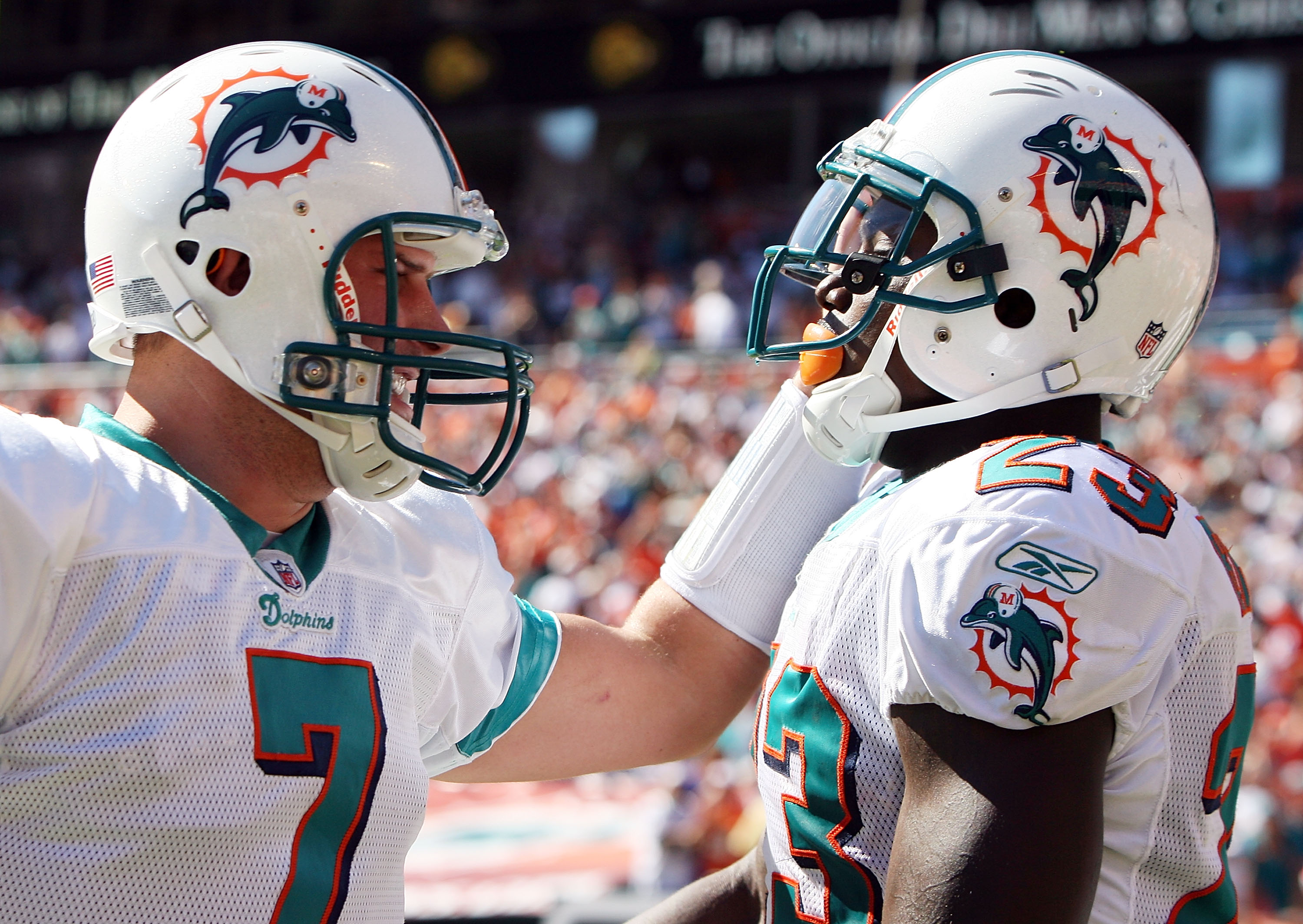 MIAMI GARDENS, FL - NOVEMBER 15:  Quarterback Chad Henne #7 and running back Ronnie Brown #23 of the Miami Dolphins celebrate after a long run against the Tampa Bay Buccaneers at Land Shark Stadium on November 15, 2009 in Miami Gardens, Florida. The Dolph