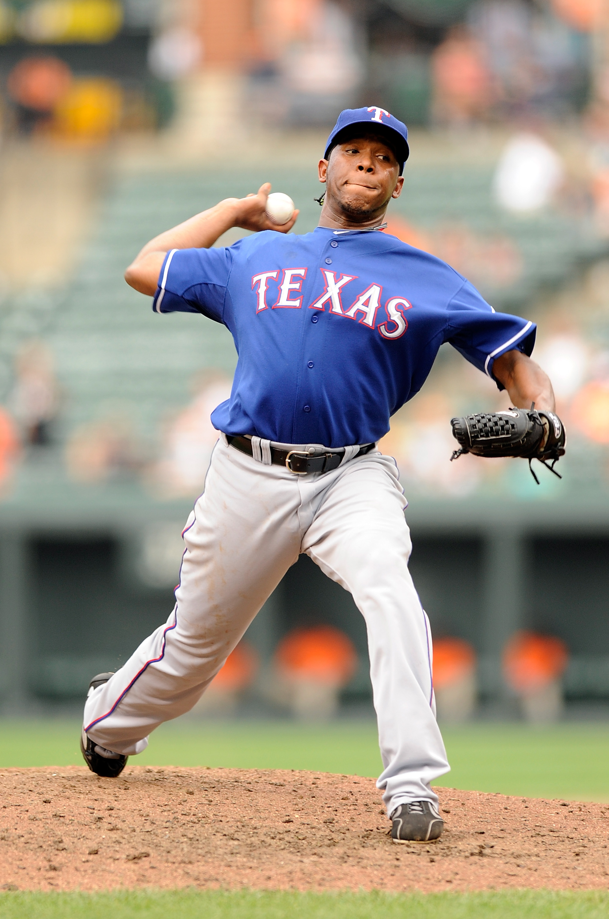 BALTIMORE - AUGUST 22:  Neftali Feliz #30 of the Texas Rangers pitches against the Baltimore Orioles at Camden Yards on August 22, 2010 in Baltimore, Maryland. The Rangers beat the Orioles 6-4.  (Photo by Greg Fiume/Getty Images)