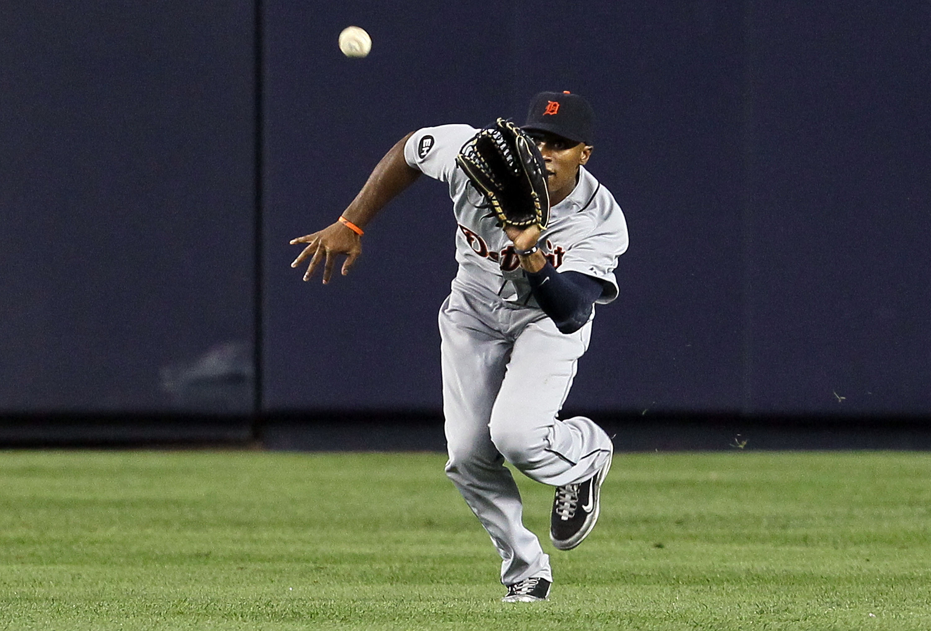 NEW YORK - AUGUST 16:  Austin Jackson #14 of the Detroit Tigers makes a catch for an out against the New York Yankees on August 16, 2010 at Yankee Stadium in the Bronx borough of New York City.  (Photo by Jim McIsaac/Getty Images)