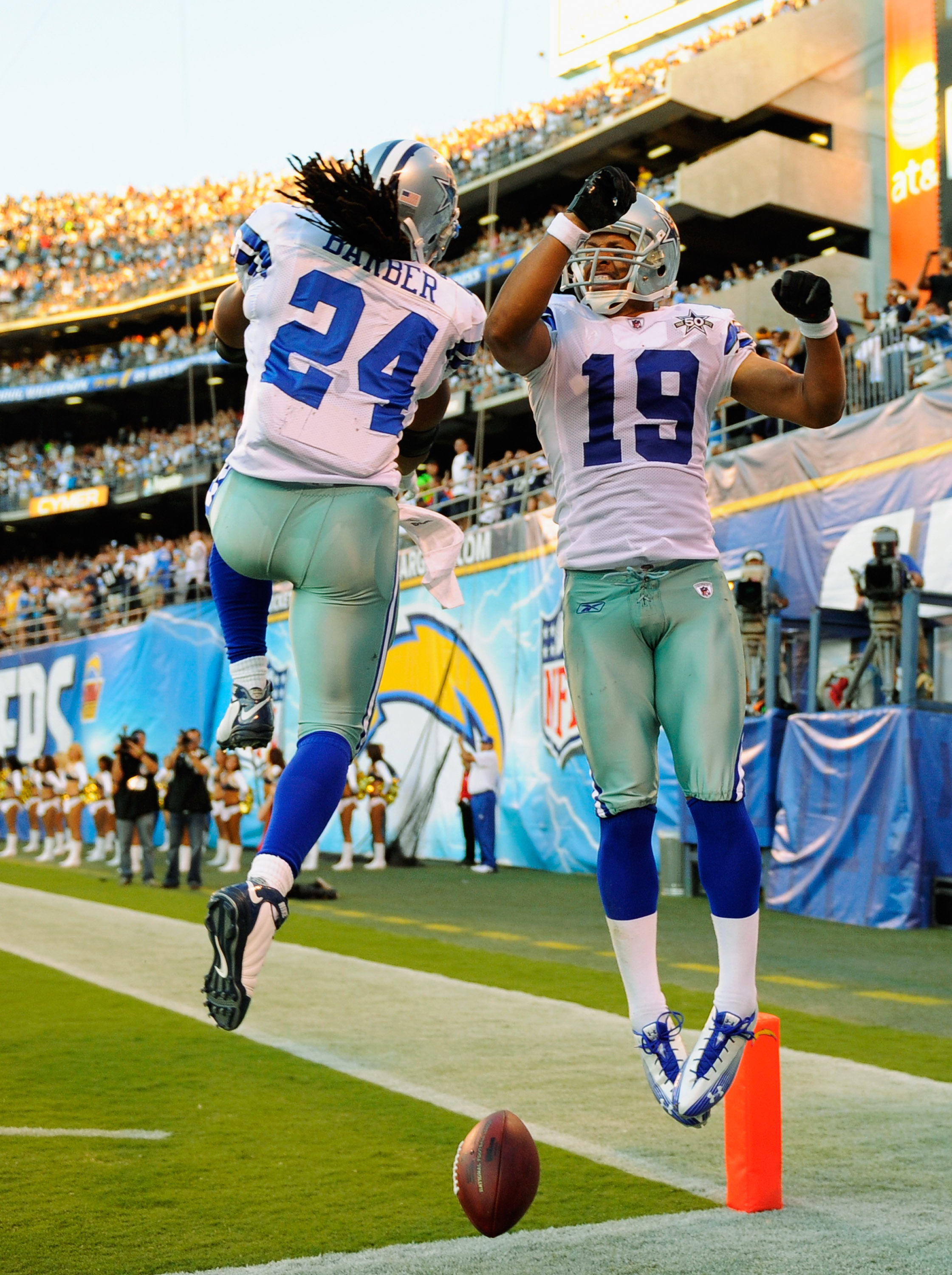 SAN DIEGO - AUGUST 21:  Wide receiver Miles Austin #19 of the Dallas Cowboys celebrates with teammate Marion Barber #24 after scoring a touchdown the San Diego Chargers during their pre-season NFL football game at Qualcomm Stadium on August 21, 2010 in Sa