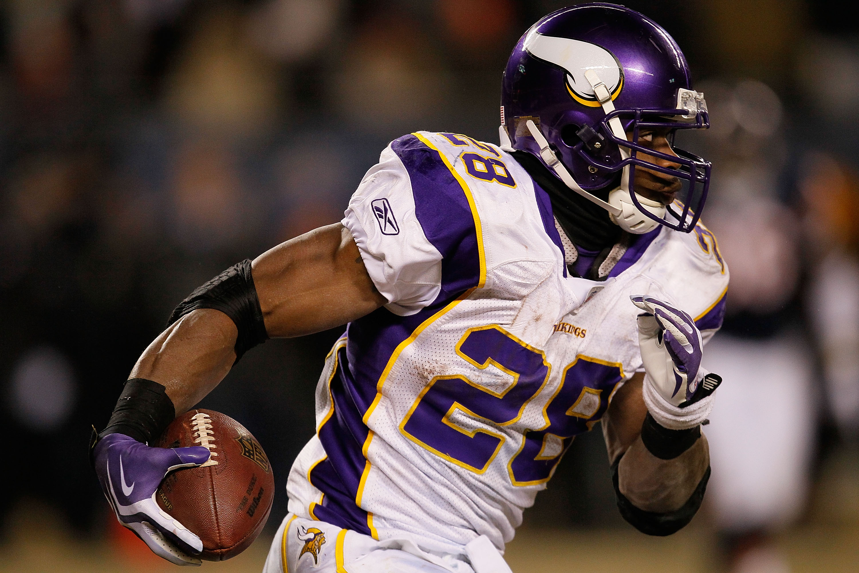 CHICAGO - DECEMBER 28: Adrian Peterson #28 of the Minnesota Vikings runs against the Chicago Bears at Soldier Field on December 28, 2009 in Chicago, Illinois. The Bears defeated the Vikings 36-30 in overtime.  (Photo by Jonathan Daniel/Getty Images)