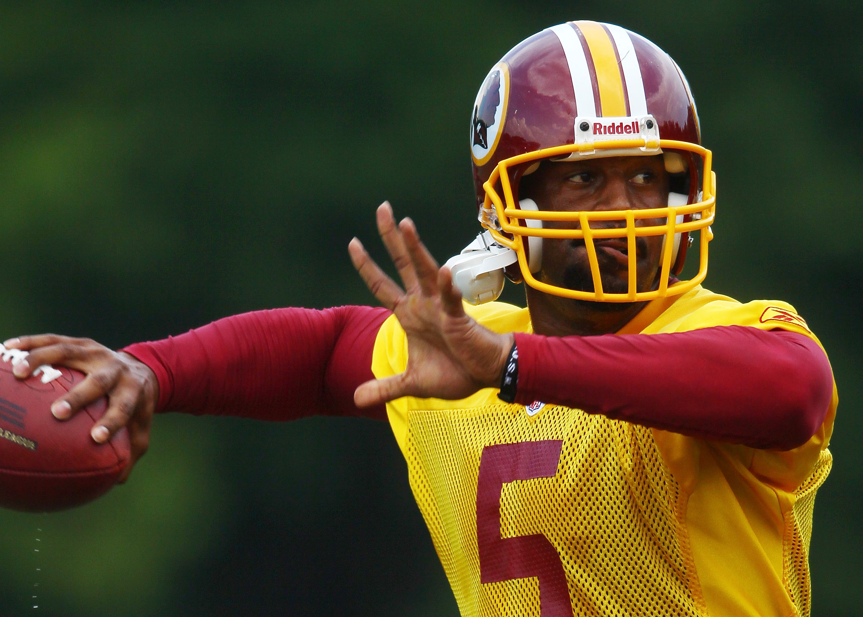 ASHBURN, VA - JULY 29:  Quarterback Donovan McNabb #5 of the Washington Redskins throws a pass during drills on the first day of training camp July 29, 2010 in Ashburn, Virginia.  (Photo by Win McNamee/Getty Images)