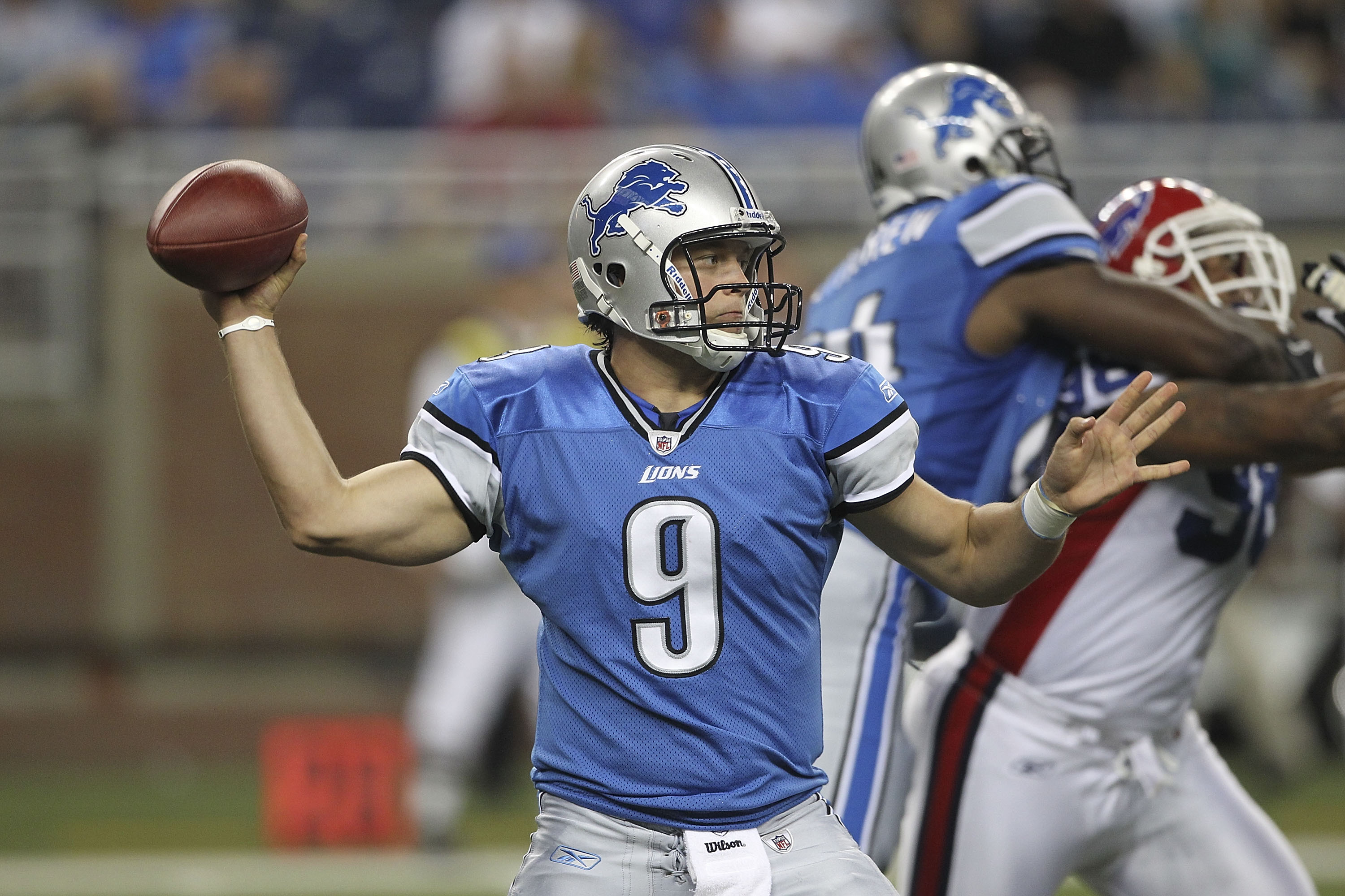 DETROIT - SEPTEMBER 02:  Matthew Stafford #9 of the Detroit Lions drops back to pass in the first quarter of the preseason game against the Buffalo Bills at Ford Field on September 2, 2010 in Detroit, Michigan.  (Photo by Leon Halip/Getty Images)