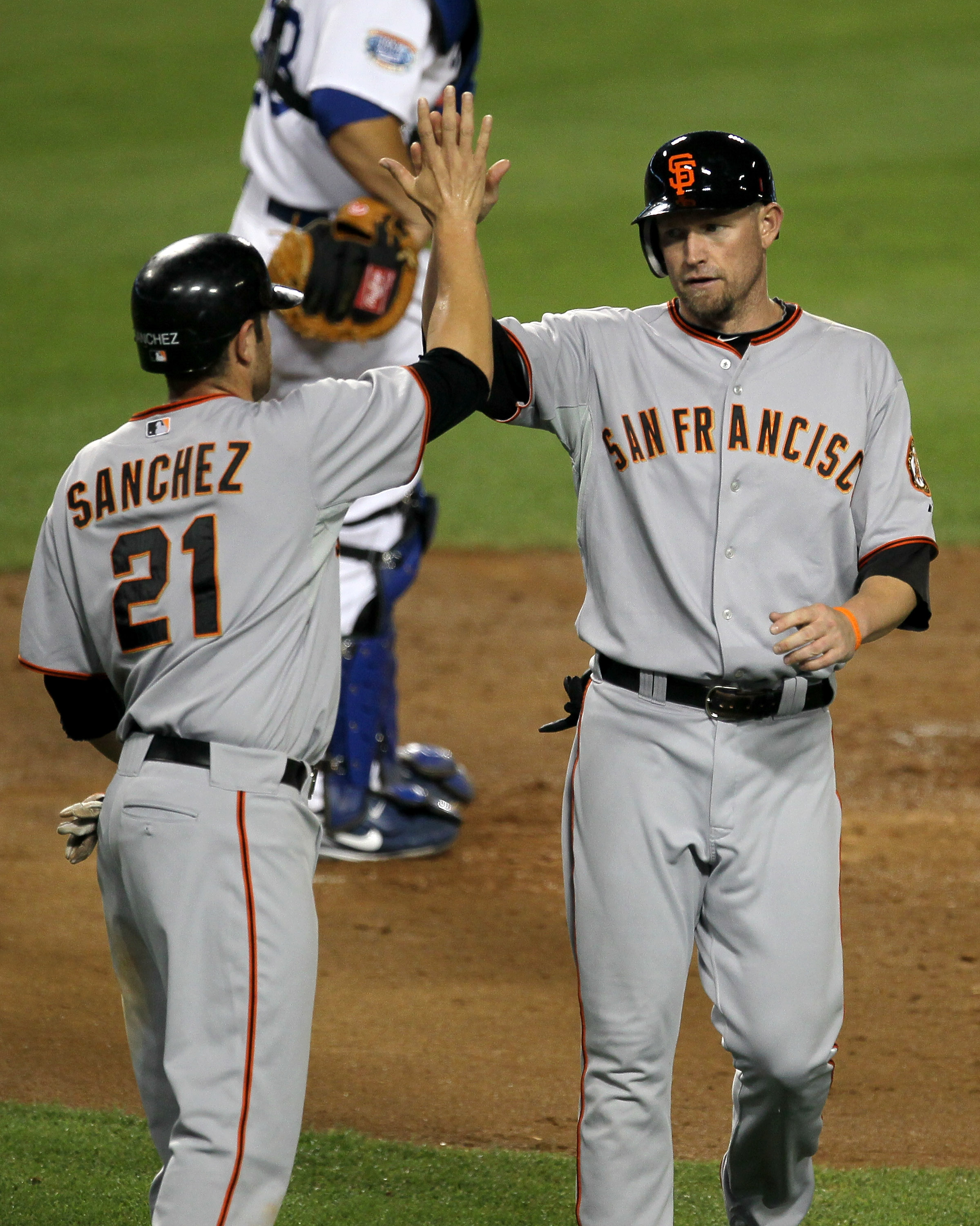 LOS ANGELES - SEPTEMBER 3:  Aubrey Huff #17 and Freddy Sanchez #21 of the San Francisco Giants celebrate after they score on Buster Posey's fourth inning single against the Los Angeles Dodgers on September 3, 2010 at Dodger Stadium in Los Angeles, Califor