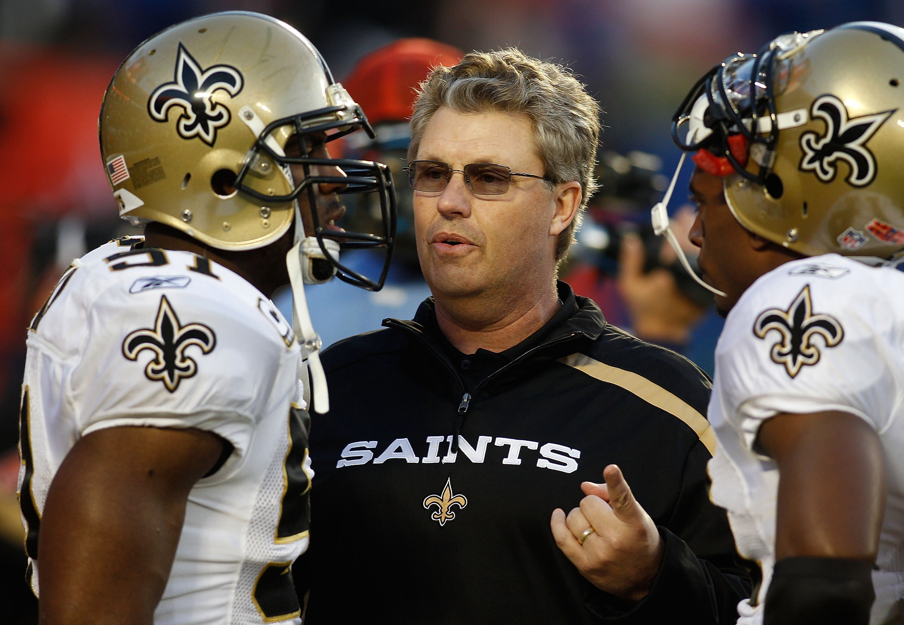 MIAMI GARDENS, FL - FEBRUARY 07:  Defensive coordinator Gregg Williams (C) of the New Orleans Saints talks with Jonathan Vilma #51 (L) and Roman Harper #41 (R) on the field prior to Super Bowl XLIV against the Indianapolis Colts on February 7, 2010 at Sun