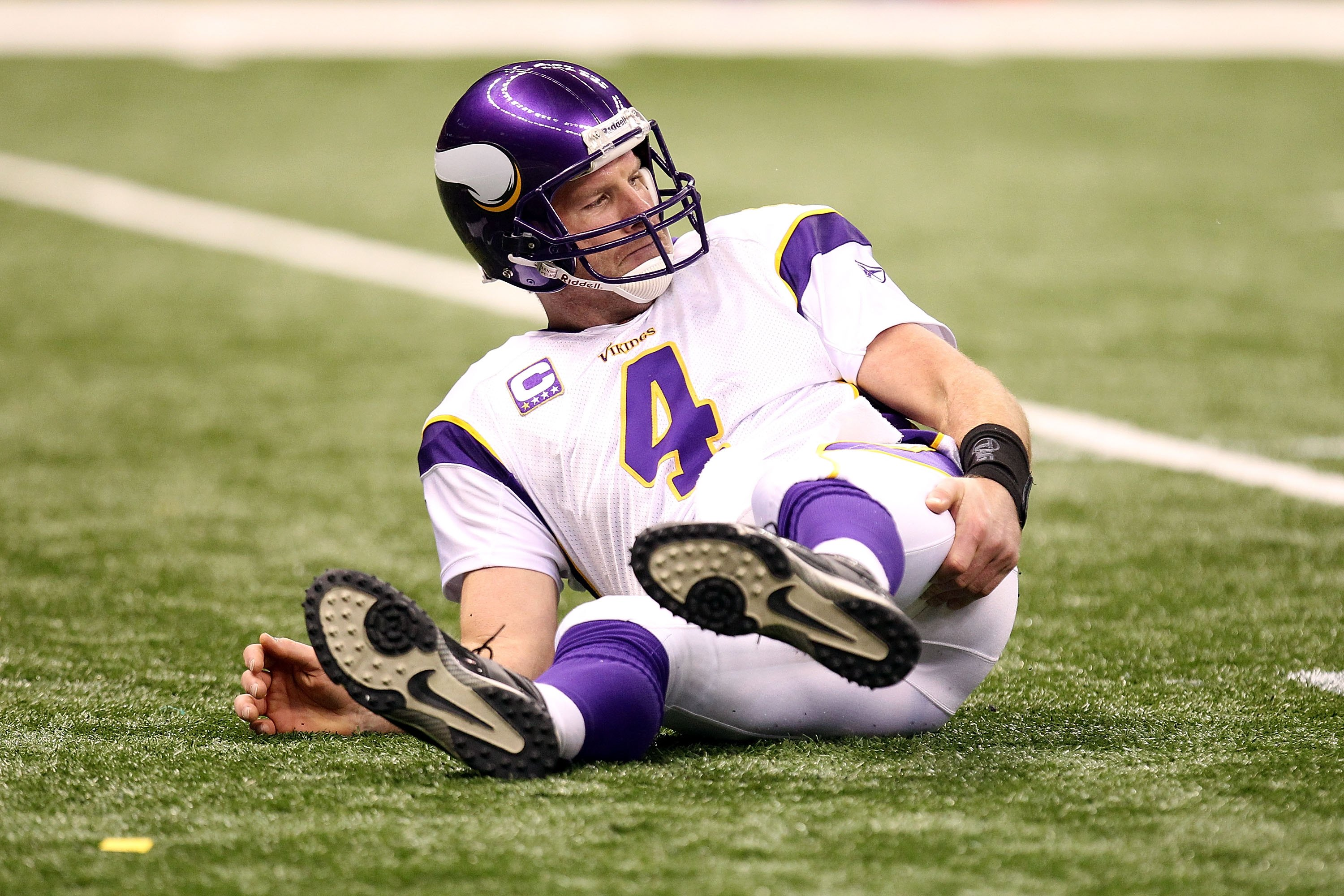 NEW ORLEANS - JANUARY 24:  Brett Favre #4 of the Minnesota Vikings grabs the back of his right leg as he sits on the turf after getting knocked down on a play against the New Orleans Saints during the NFC Championship Game at the Louisiana Superdome on Ja