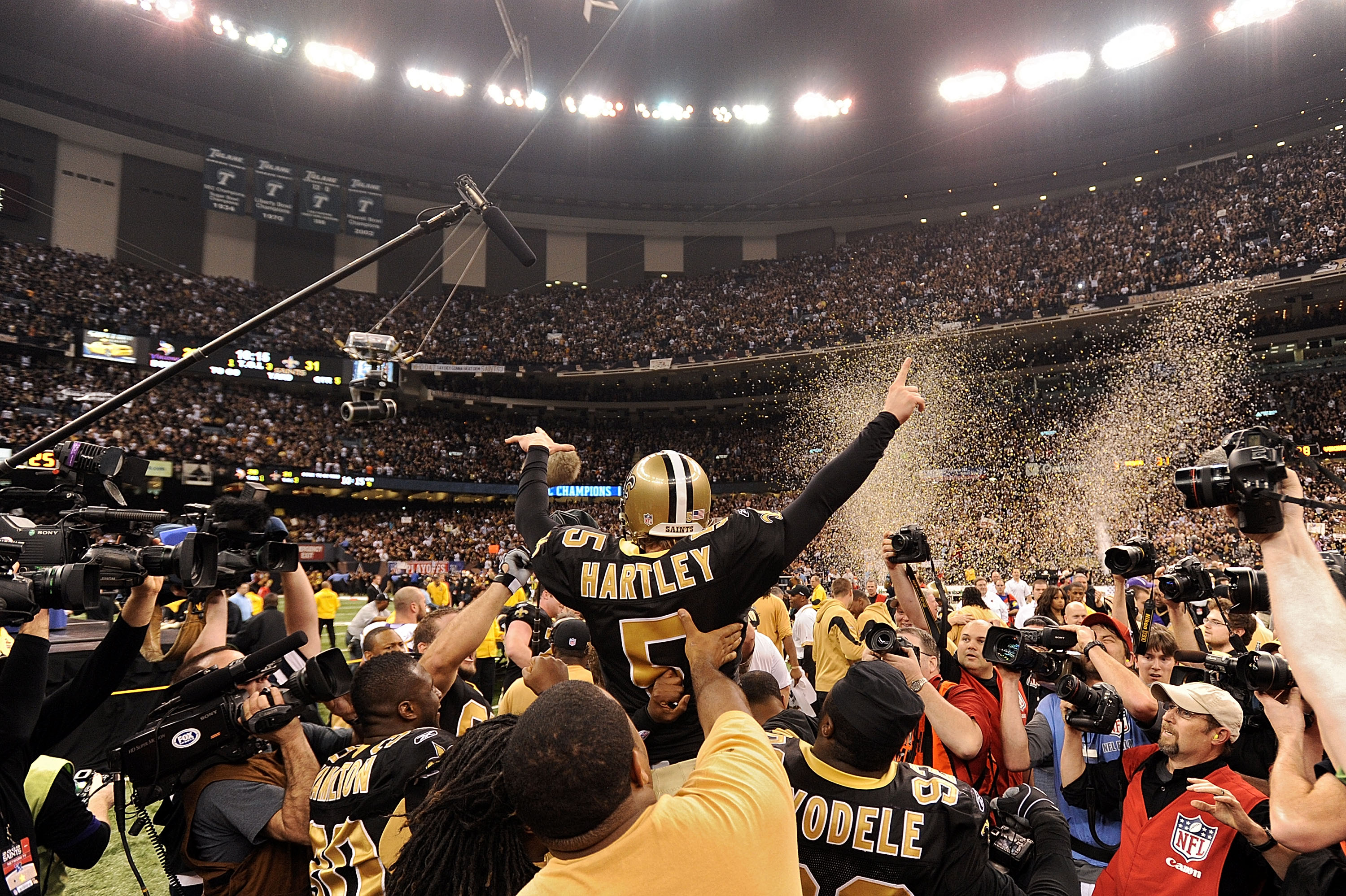 NEW ORLEANS - JANUARY 24:  Kicker Garrett Hartley #5 of the New Orleans Saints is mobbed by teammates after hitting a gaming winning field goal in overtime against the Minnesota Vikings to win the NFC Championship Game at the Louisiana Superdome on Januar