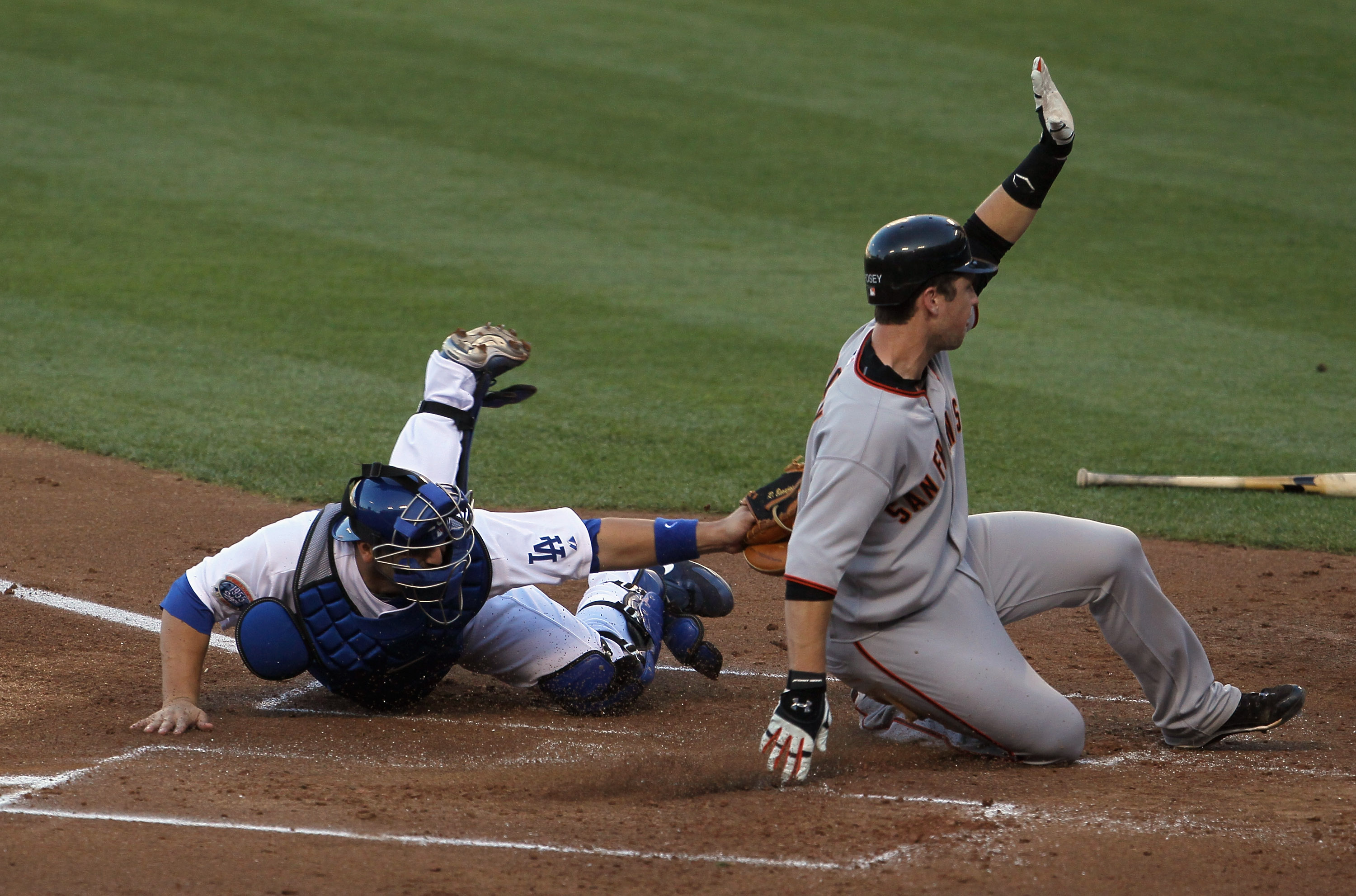 LOS ANGELES, CA - SEPTEMBER 05:  Buster Posey #28 of the San Francisco Giants slides safely past catcher Rod Barajas #28 of the Los Angeles Dodgers in the second inning at Dodger Stadium on September 5, 2010 in Los Angeles, California.  (Photo by Jeff Gro