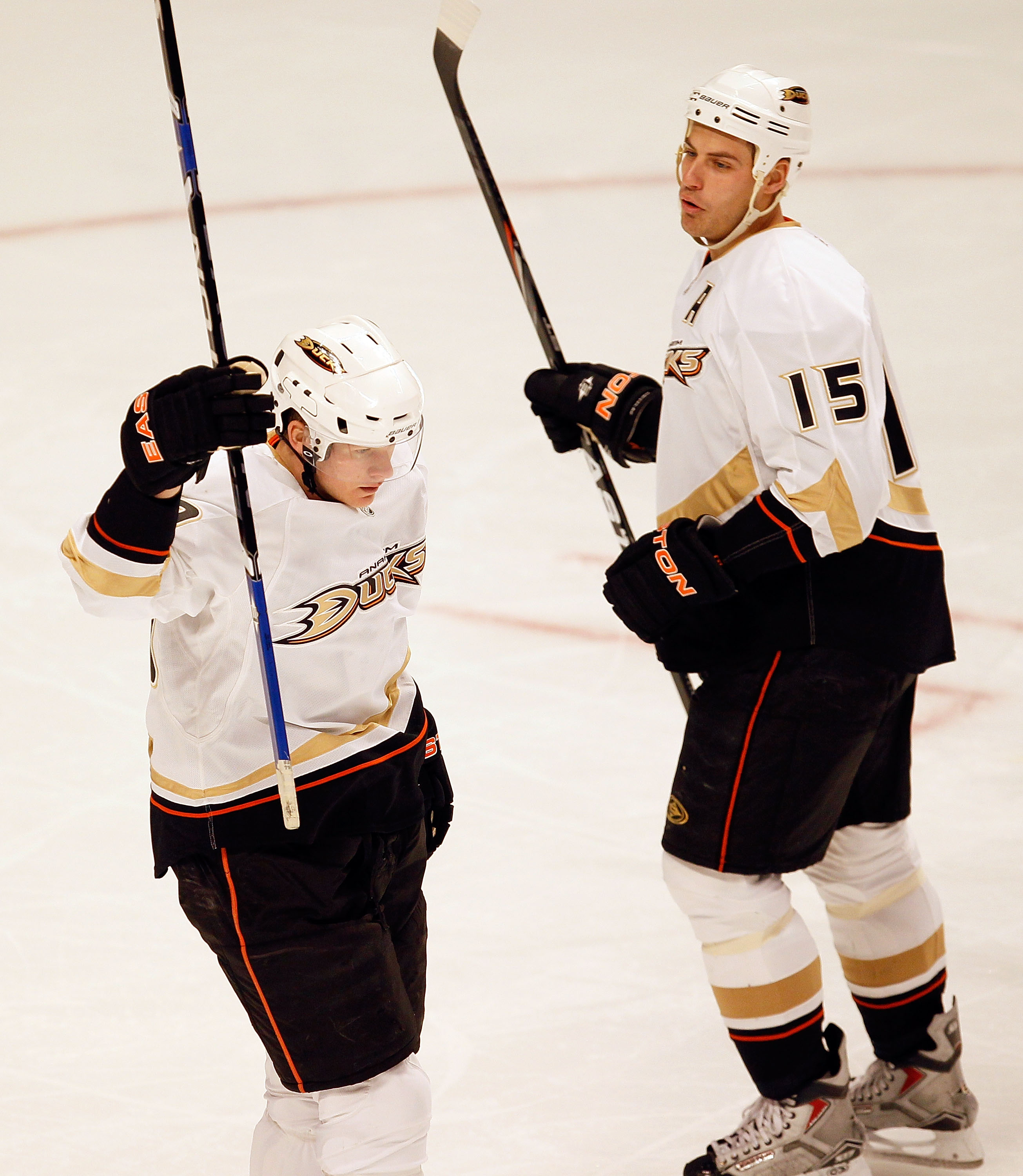 CHICAGO - JANUARY 10: Corey Perry #10 of the Anaheim Ducks celebrates a first period goal against the Chicago Blackhawks as teammate Ryan Getzlaf #15 skates to join him at the United Center on January 10, 2010 in Chicago, Illinois. (Photo by Jonathan Dani