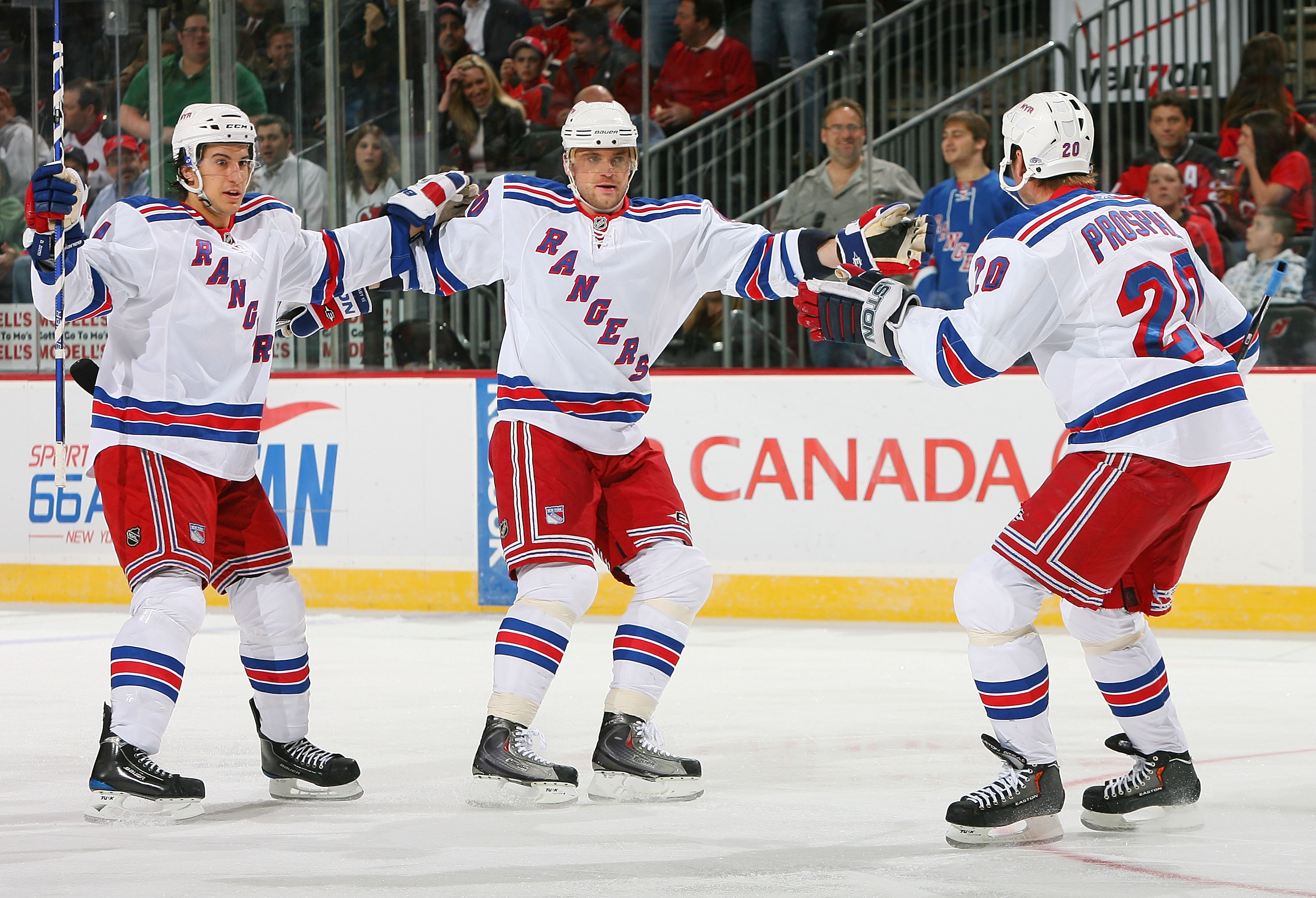 NEWARK, NJ - JANUARY 10:  Vinny Prospal #20 of the New York Rangers celebrates his first-period goal with teammates Marian Gaborik #10 and Michael del Zotto #4 during NHL action against the New Jersey Devils at the Prudential Center on March 10, 2010 in N