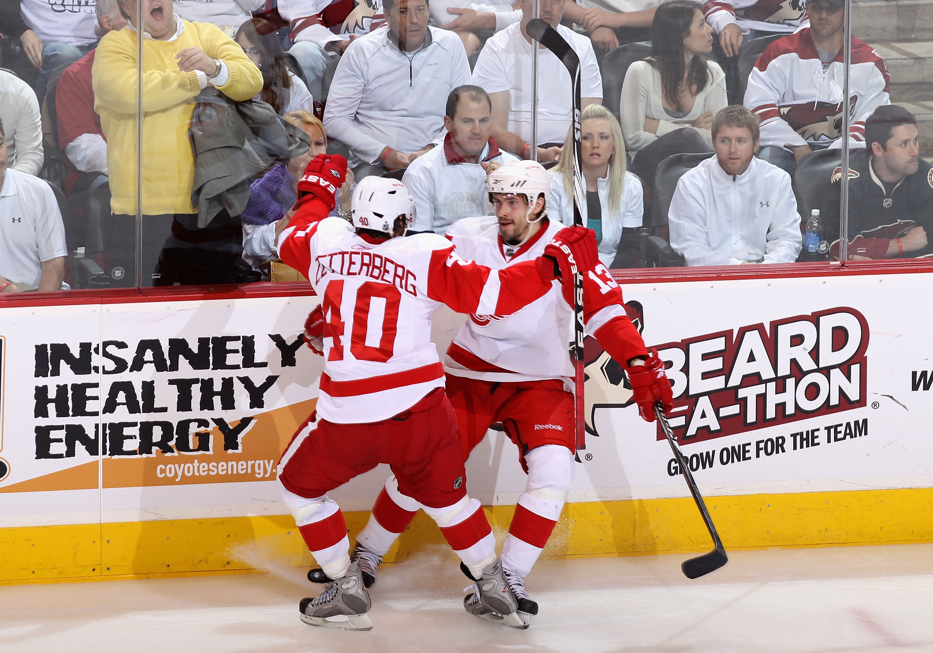 GLENDALE, AZ - APRIL 27:  Pavel Datsyuk #13 of the Detroit Red Wings celebrates with teammate Henrik Zetterberg #40 after Datsyuk scored a second period goal against the Phoenix Coyotes in Game Seven of the Western Conference Quarterfinals during the 2010