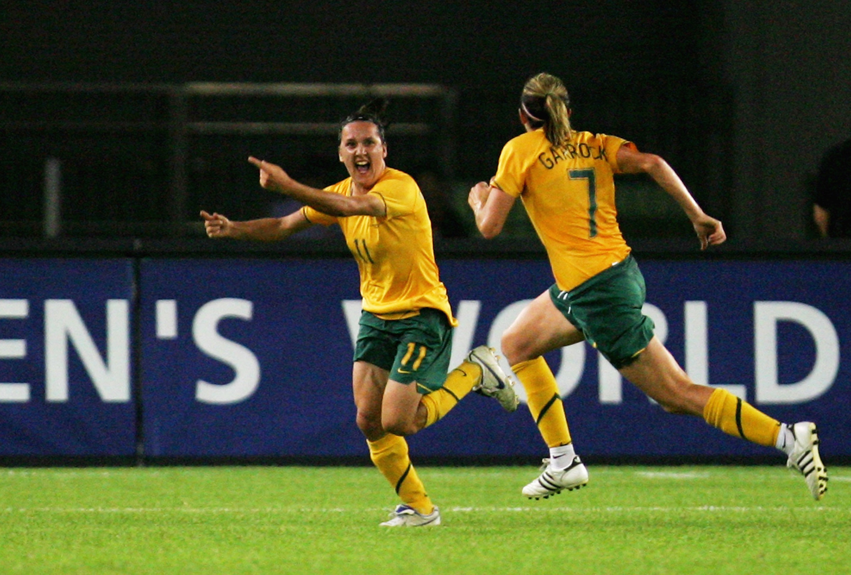 HANGZHOU, ZHEJIANG - SEPTEMBER 15:  Lisa De Vanna (L) of Australia celebrates a goal against Norway during the FIFA Women's World Cup 2007 Group C match between Australia and Norway at Hangzhou Dragon Stadium on September 15, 2007 in Hangzhou, Zhejiang pr
