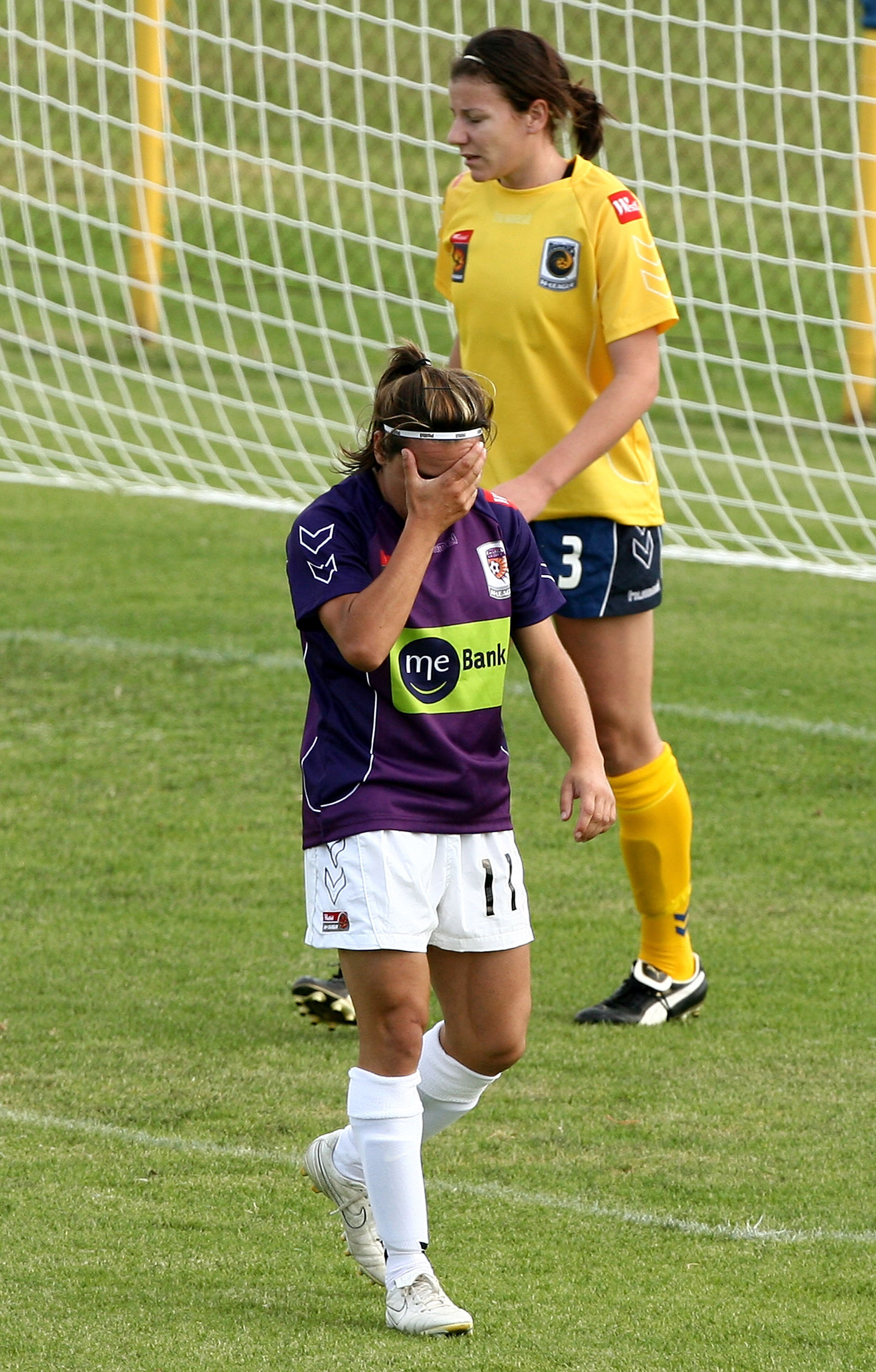PERTH, AUSTRALIA - NOVEMBER 07: Lisa De Vanna of the Glory reacts after missing a shot on goal during the round six W-League match between the Perth Glory and the Central Coast Mariners at Clipsal Stadium on November 7, 2009 in Perth, Australia.  (Photo b