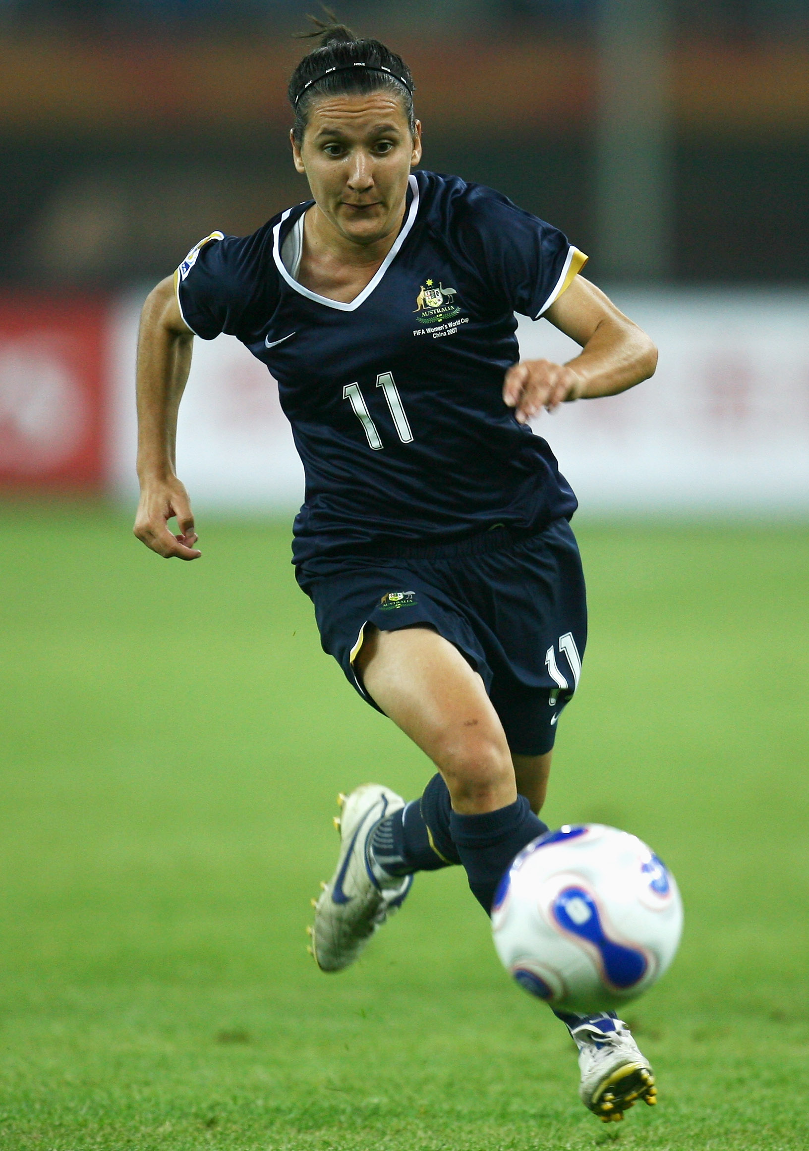 TIANJIN, CHINA - SEPTEMBER 23:  Lisa De Vanna of Australia in action during the Quarter Final of the Women's World Cup 2007 match between Brasil and Australia at Tianjin Olympic Center Stadium on September 23, 2007 in Tianjin, China.  (Photo by Paul Gilha