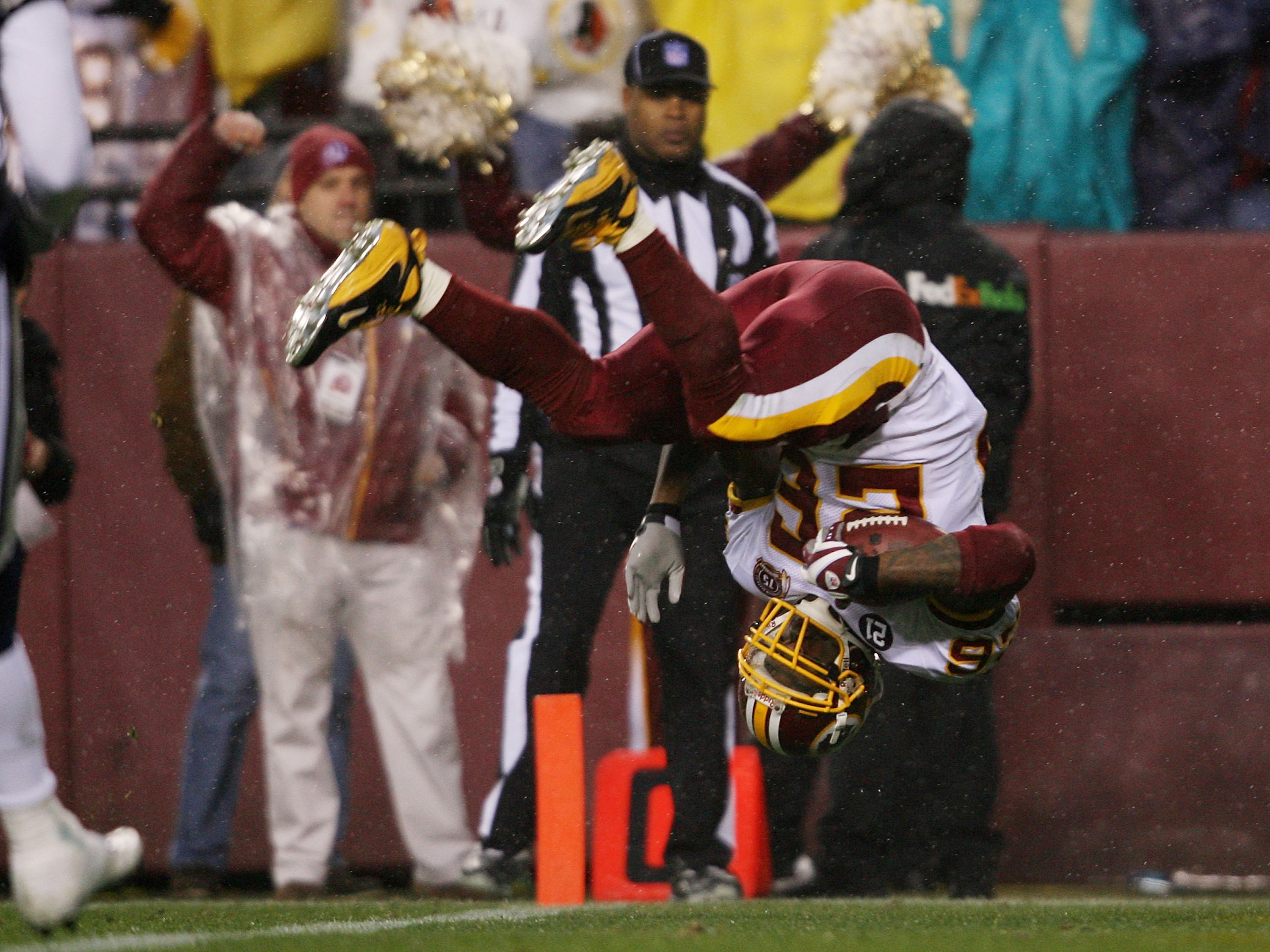 LANDOVER, MD  - DECEMBER 30:   Clinton Portis #26 of the Washington Redskins does a somersault into the endzone as he scores a first quarter touchdown against the Dallas Cowboys on his way to a touchdown on December 30, 2007 at FedEx Field in Landover, Ma