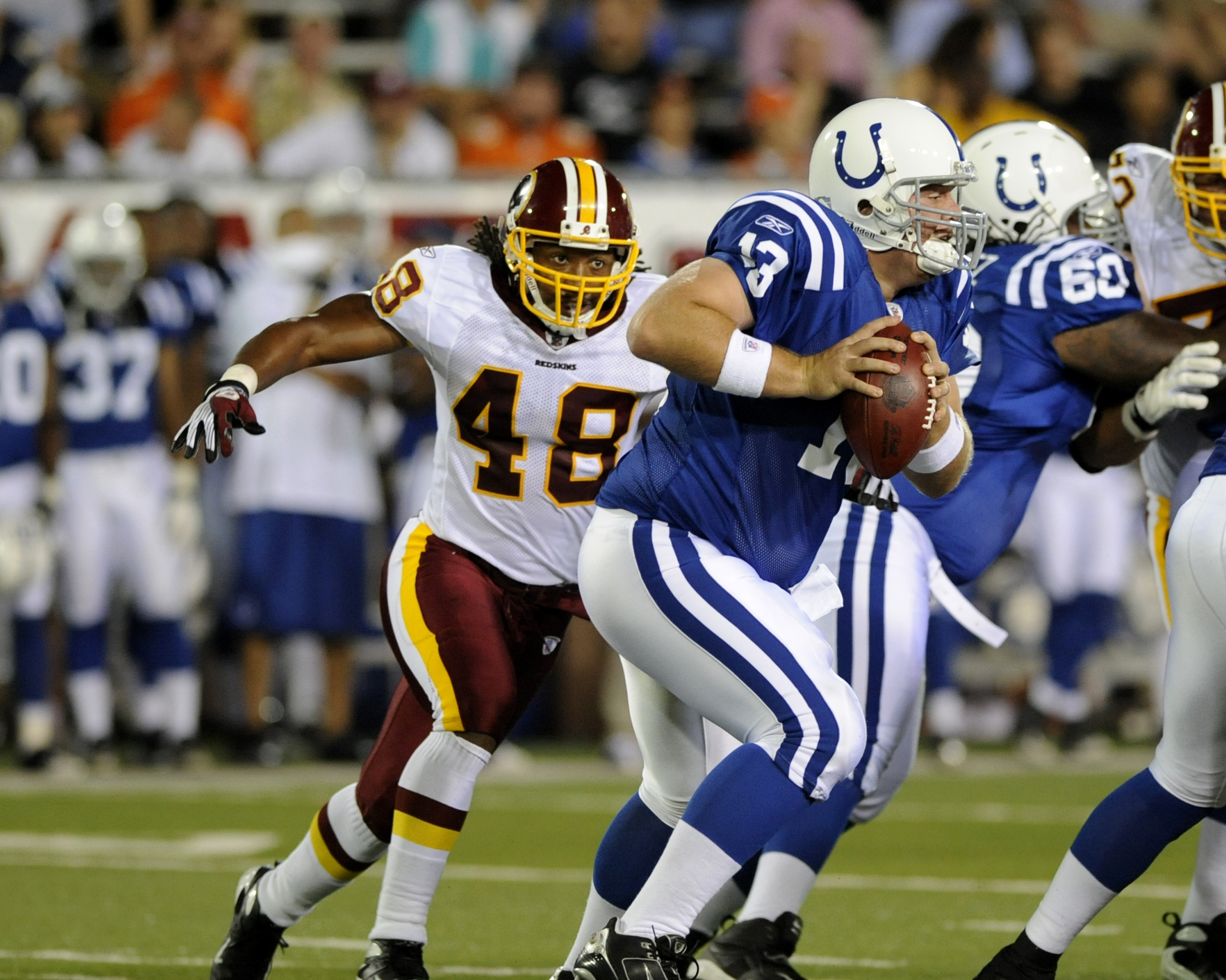 CANTON, OH - AUGUST 3:  Safety Chris Horton #48 of the Washington Redskins looks for a sack against the Indianapolis Colts in the Pro Football Hall of Fame Game at Fawcett Stadium on August 3, 2008 in Canton, Ohio.   (Photo by Al Messerschmidt/Getty Image