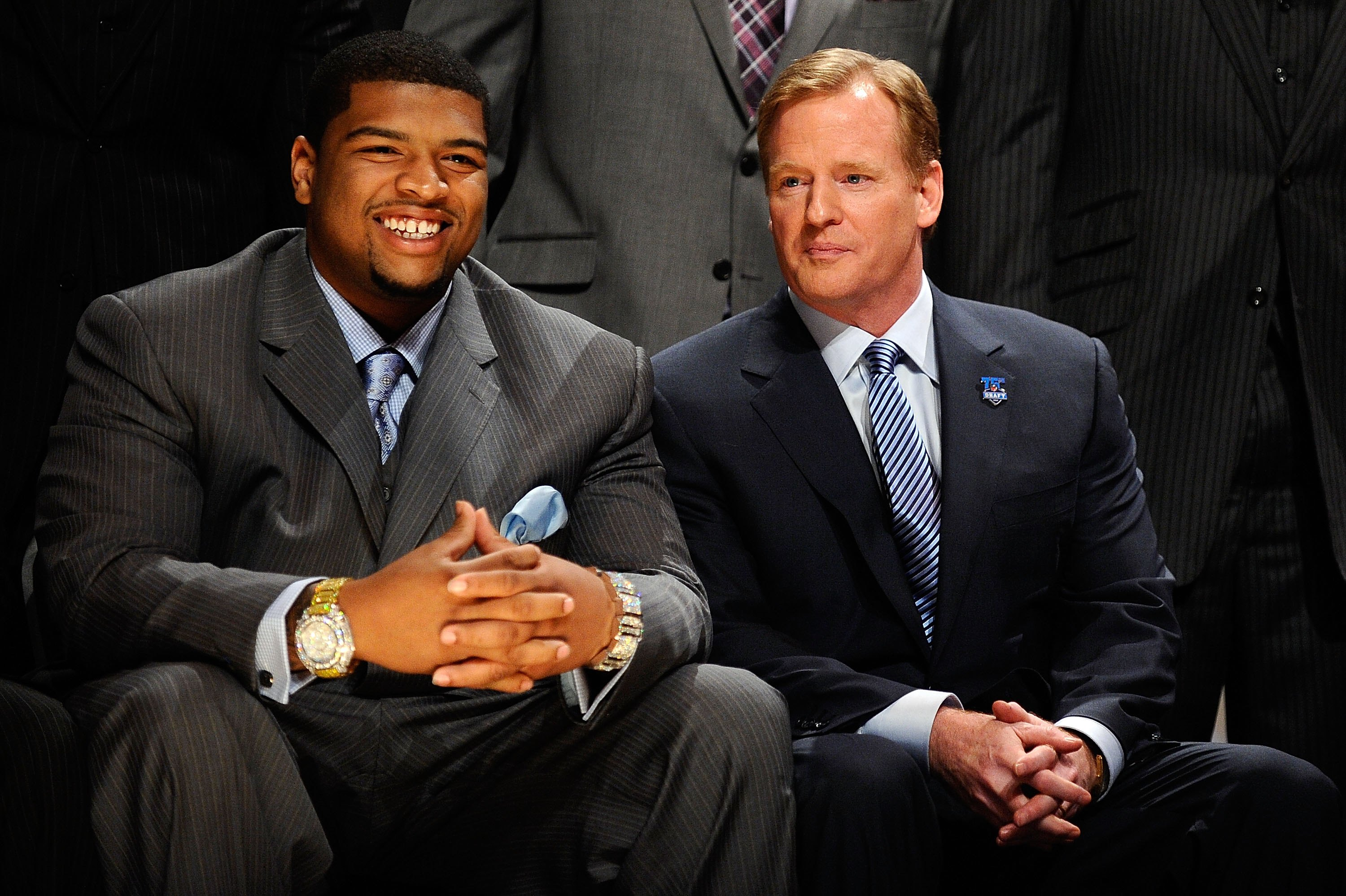 NEW YORK - APRIL 22:  Trent Williams from the Oklahoma Sooners (who was drafted #4 overall by the Washington Redskins) sits with NFL Commissioner Roger Goodell (R) during the first round of the 2010 NFL Draft at Radio City Music Hall on April 22, 2010 in