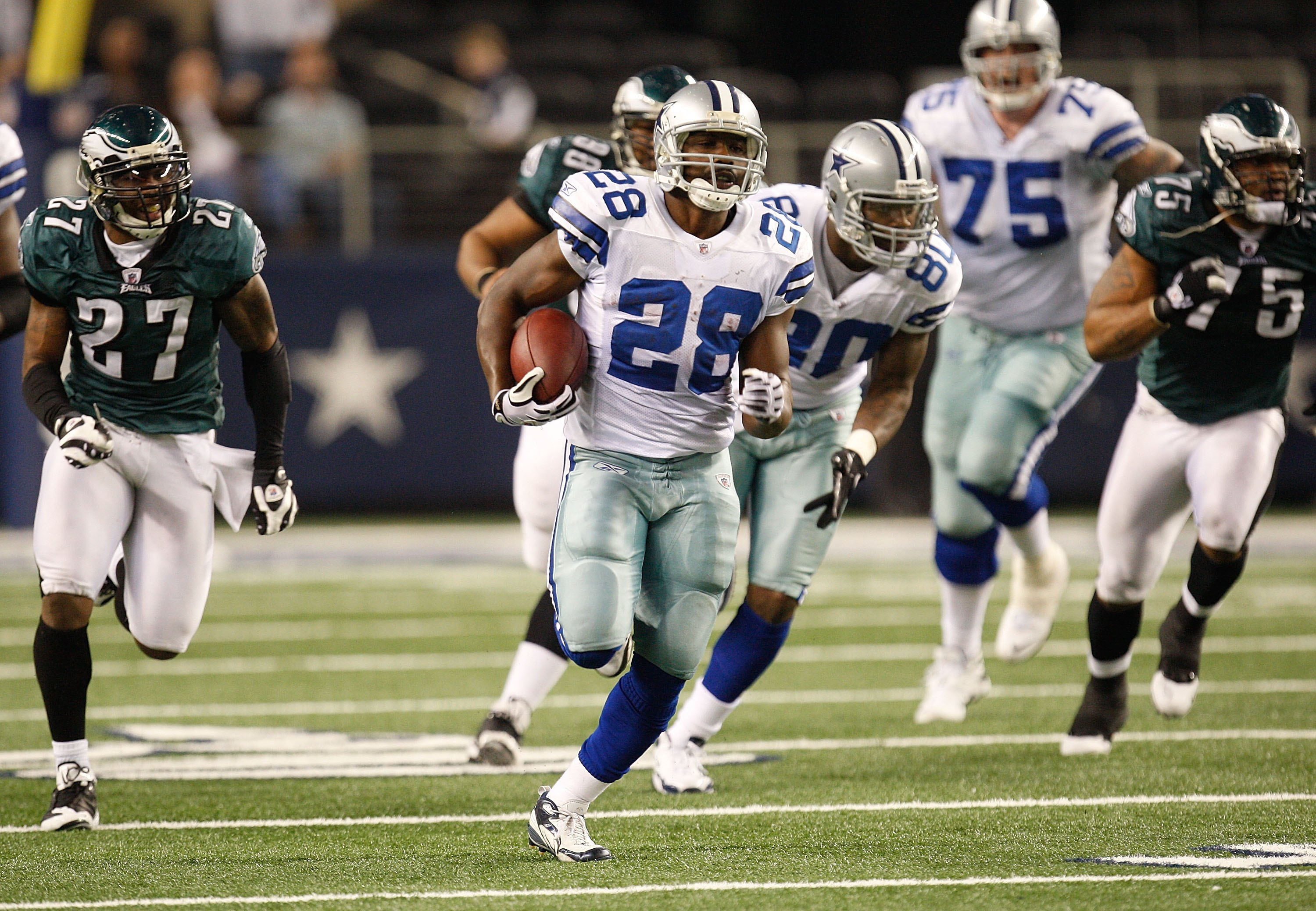 ARLINGTON, TX - JANUARY 09:  Running back Felix Jones #28 of the Dallas Cowboys runs the ball against the Philadelphia Eagles during the 2010 NFC wild-card playoff game at Cowboys Stadium on January 9, 2010 in Arlington, Texas.  (Photo by Ronald Martinez/