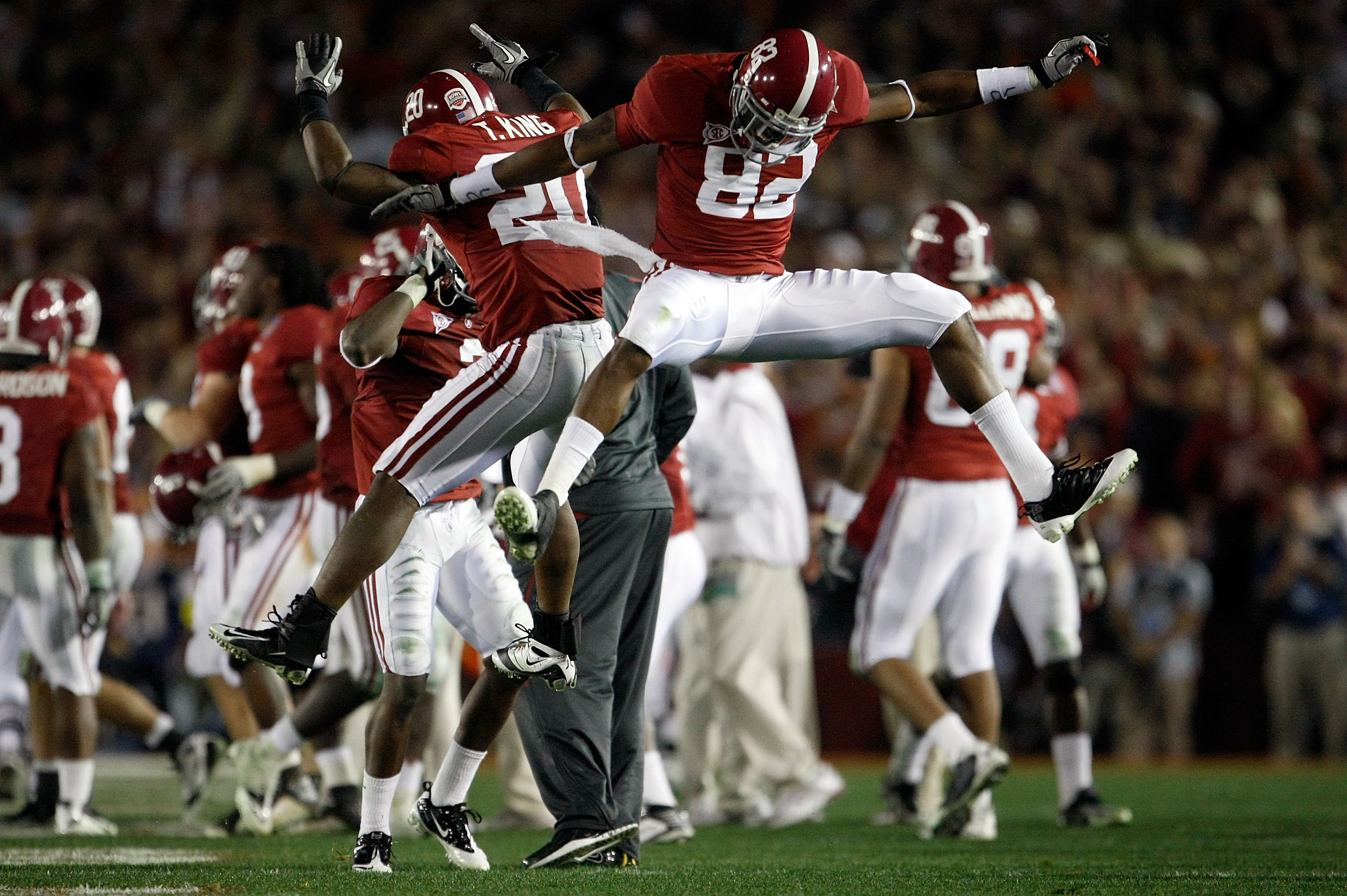 PASADENA, CA - JANUARY 07:  Cornerback Tyrone King #20 and wide receiver Earl Alexander #82 of the Alabama Crimson Tide celebrate during the Citi BCS National Championship game against the Texas Longhorns at the Rose Bowl on January 7, 2010 in Pasadena, C