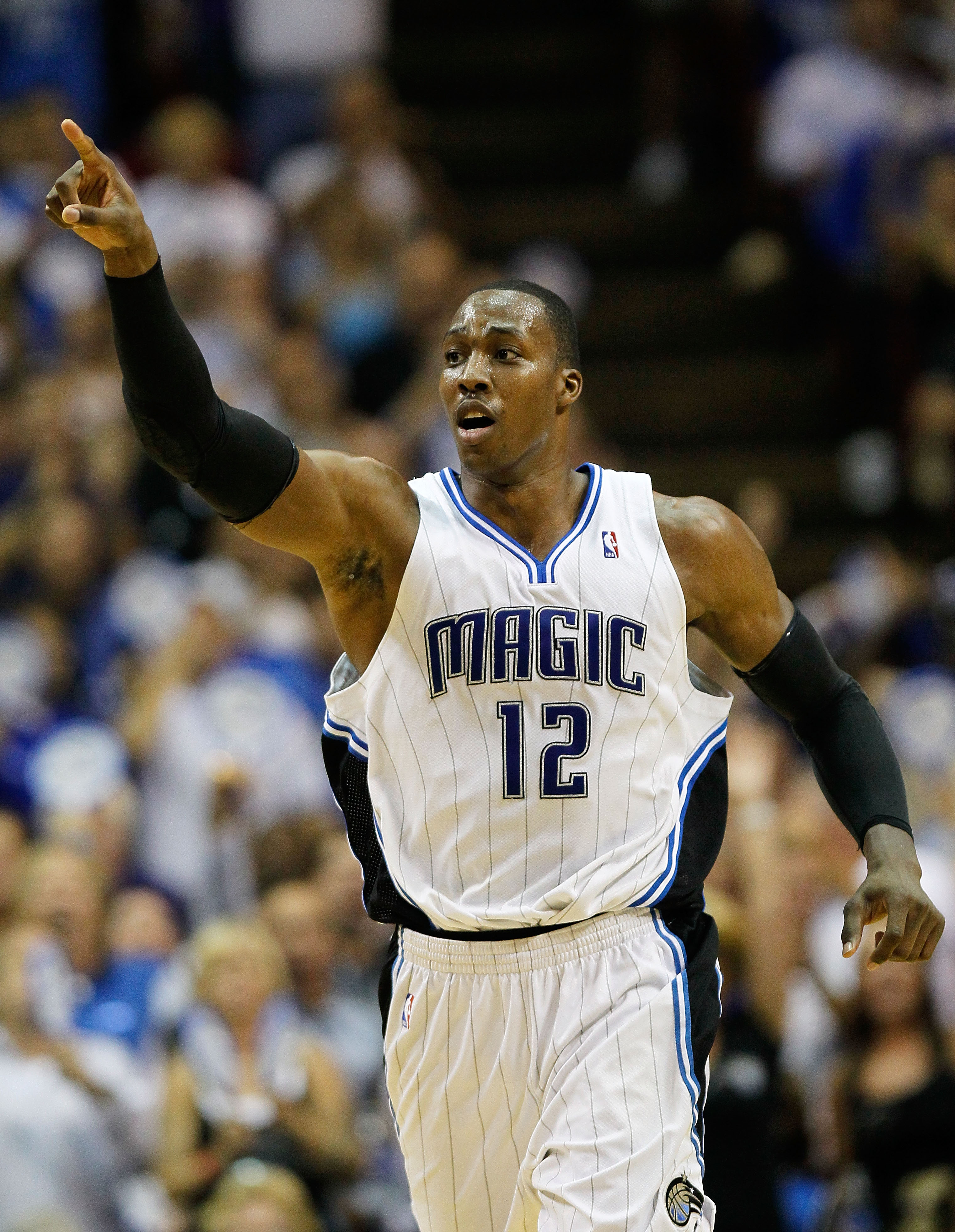 ORLANDO, FL - MAY 26:  Dwight Howard #12 of the Orlando Magic reacts against the Boston Celtics in Game Five of the Eastern Conference Finals during the 2010 NBA Playoffs at Amway Arena on May 26, 2010 in Orlando, Florida.  NOTE TO USER: User expressly ac
