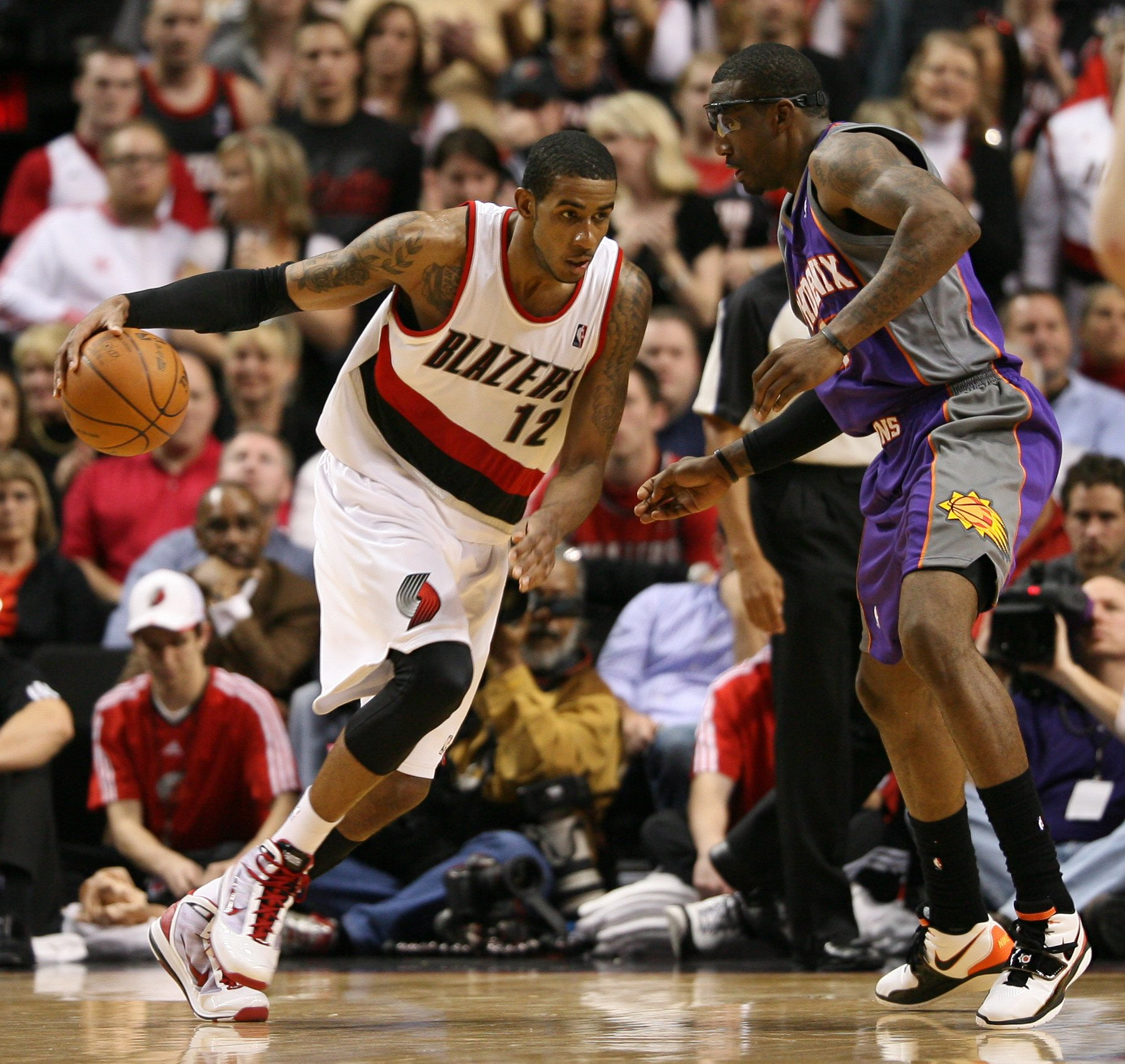 PORTLAND, OR - APRIL 29:  LaMarcus Aldridge #12 of the Portland Trail Blazers in action against Amare Stoudemire #1 of the Phoenix Suns during Game Six of the Western Conference Quarterfinals of the NBA Playoffs on April 29, 2010 at the Rose Garden in Por