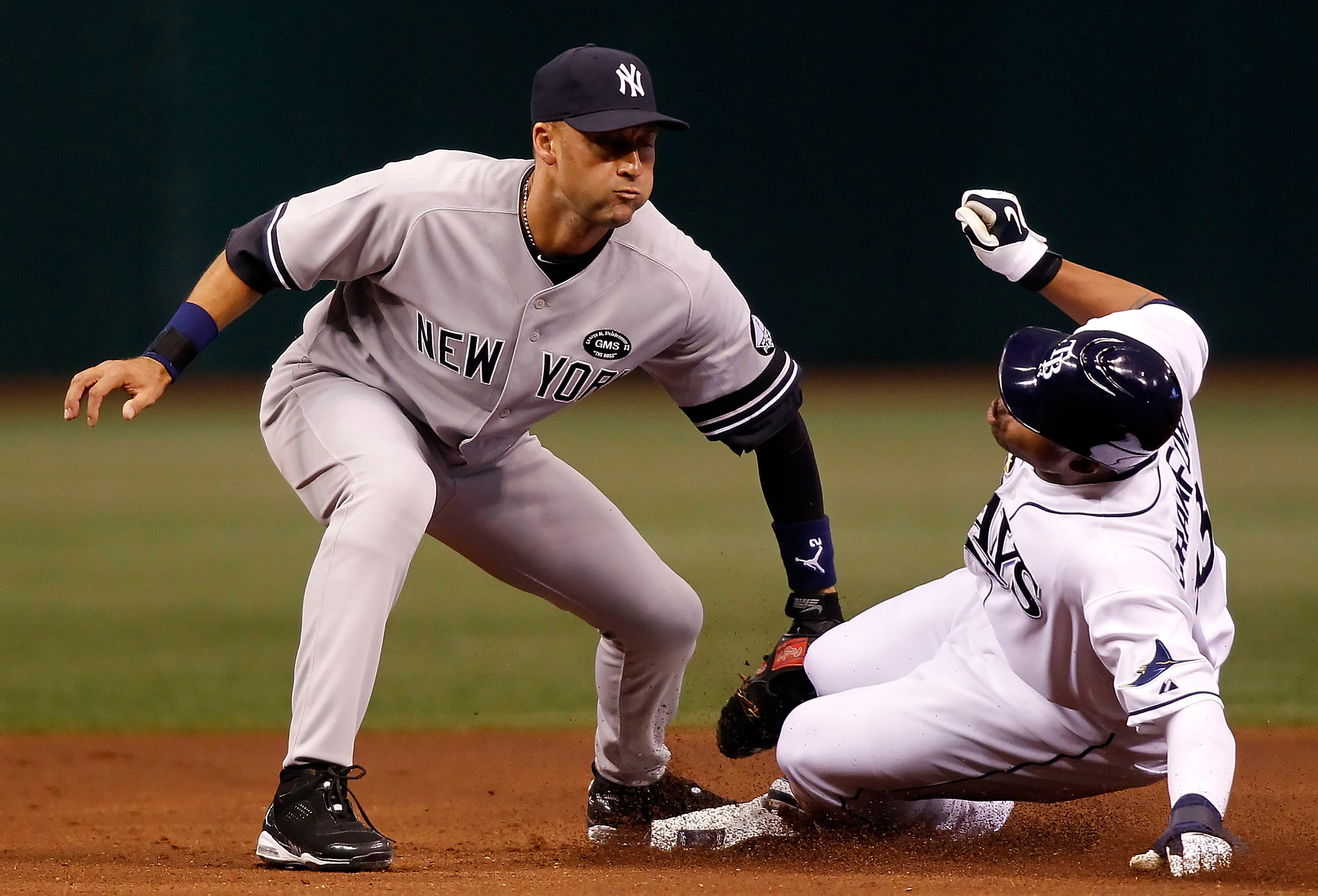 ST PETERSBURG, FL - JULY 31:  Outfielder Carl Crawford #13 of the Tampa Bay Rays steals his 400th career base as shortstop Derek Jeter #2 of the New York Yankees is late with the tag during the game at Tropicana Field on July 31, 2010 in St. Petersburg, F