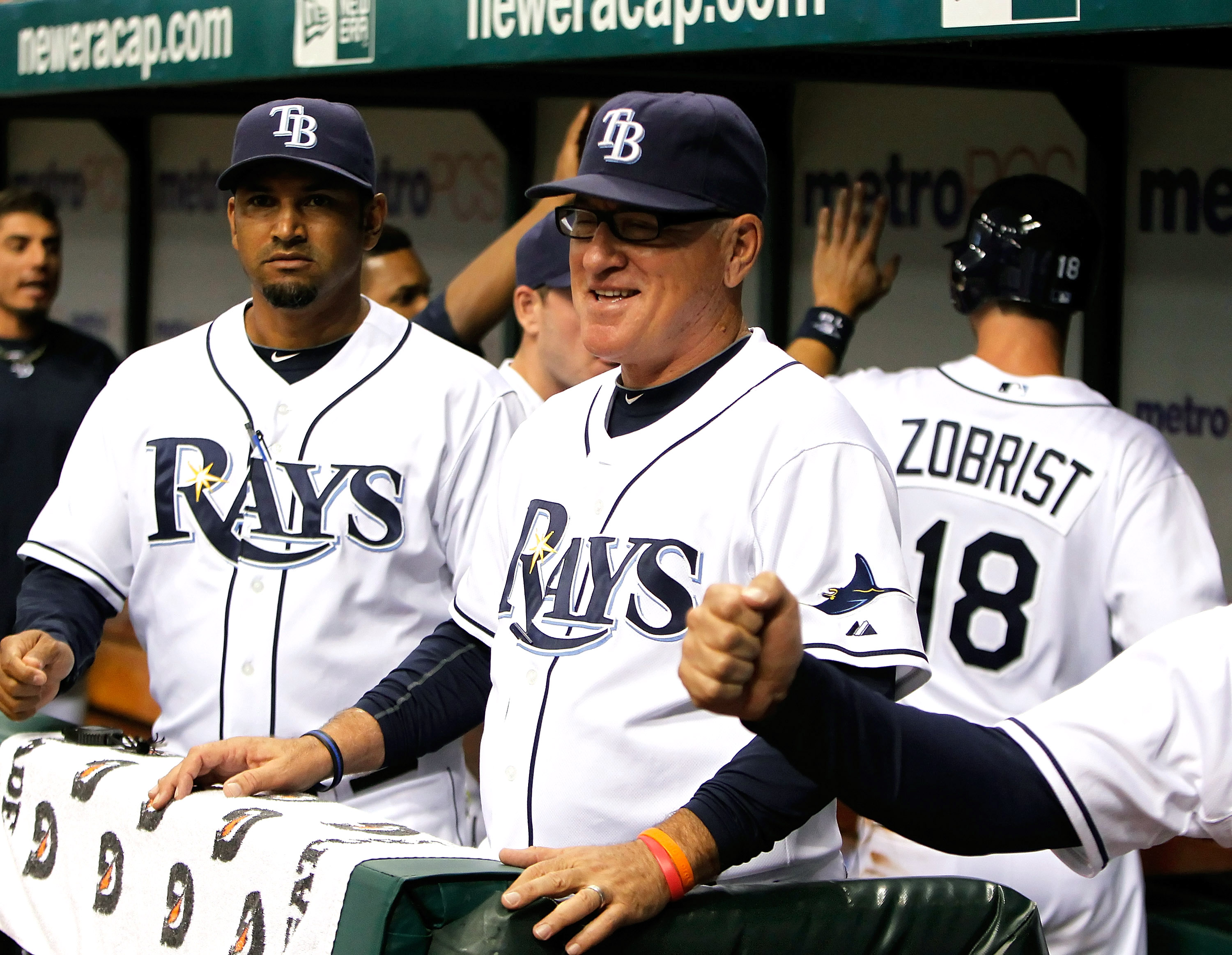 ST. PETERSBURG - AUGUST 31:  Manager Joe Maddon #70 of the Tampa Bay Rays smiles after his team scored a run against the Toronto Blue Jays during the game at Tropicana Field on August 31, 2010 in St. Petersburg, Florida.  (Photo by J. Meric/Getty Images)