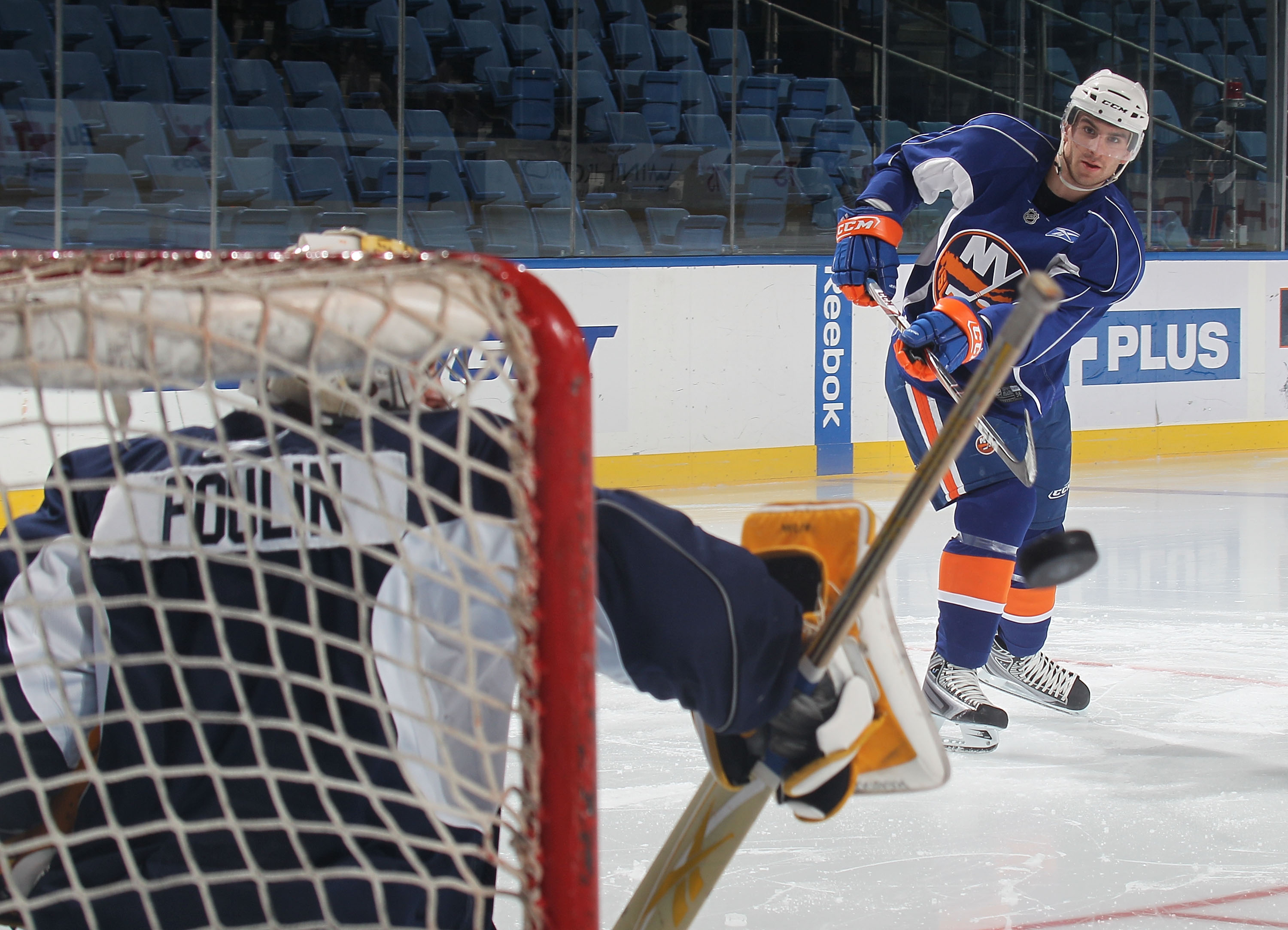 UNIONDALE, NY - JULY 07: John Tavares sends a shot at Kevin Poulin during the New York Islanders rookie camp at Nassau Veterans Memorial Coliseum on July 7, 2010 in Uniondale, New York.  (Photo by Bruce Bennett/Getty Images)