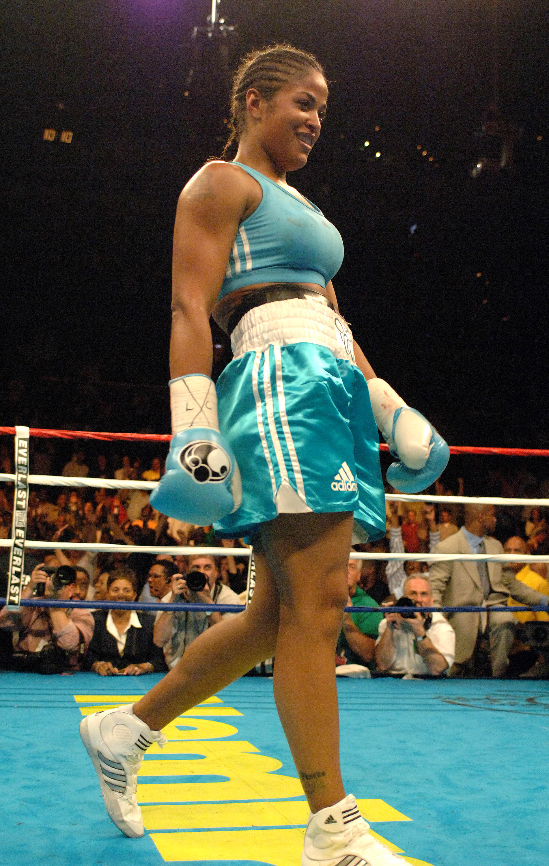 WASHINGTON - JUNE 11:  Laila Ali walks to her corner after stopping Erin Toughill in the 2nd round during their fight for the WBC and WIBA Super Middleweight championship at the MCI Center June 11, 2005 in Washington, DC. Laila Ali won the WBC and WIBA ti