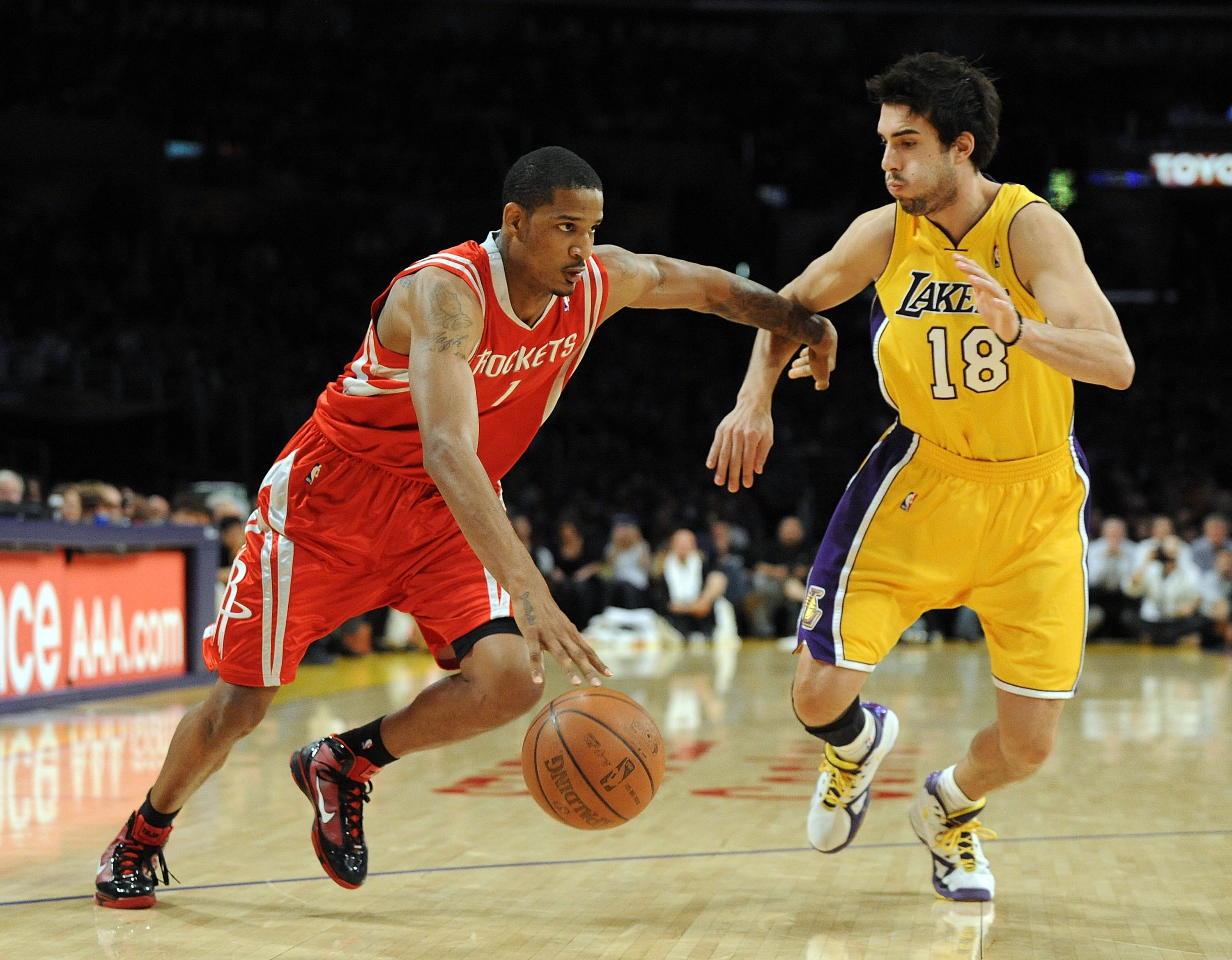 LOS ANGELES, CA - JANUARY 05:  Trevor Ariza #1 of the Houston Rockets dribbles around Sasha Vujacic #18 of the Los Angeles Lakers during the game at Staples Center on January 5, 2010 in Los Angeles, California.  NOTE TO USER: User expressly acknowledges a