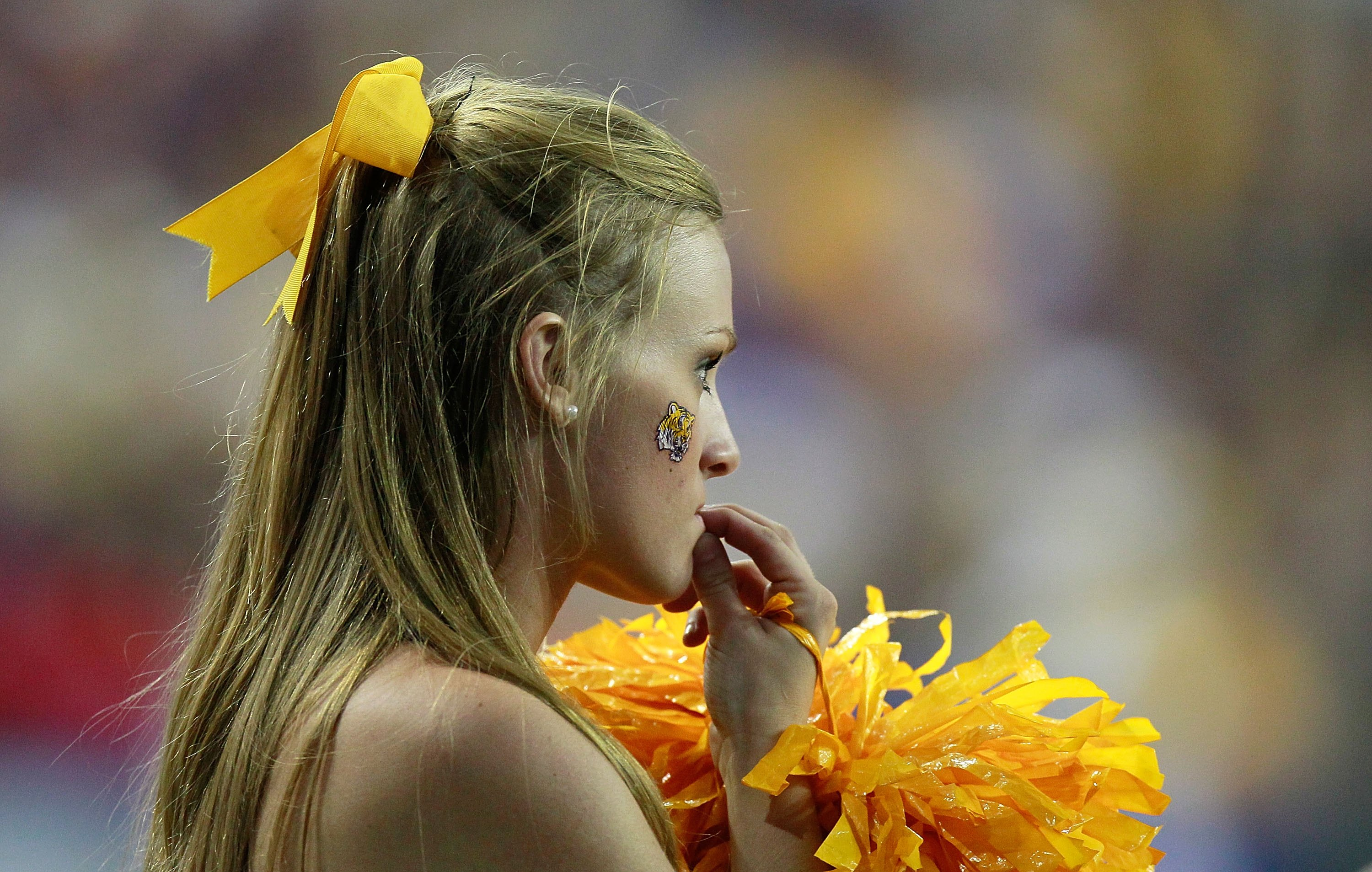 ATLANTA - SEPTEMBER 04:  A cheerleader for the LSU Tigers against the North Carolina Tar Heels during the Chick-fil-A Kickoff Game at Georgia Dome on September 4, 2010 in Atlanta, Georgia.  (Photo by Kevin C. Cox/Getty Images)