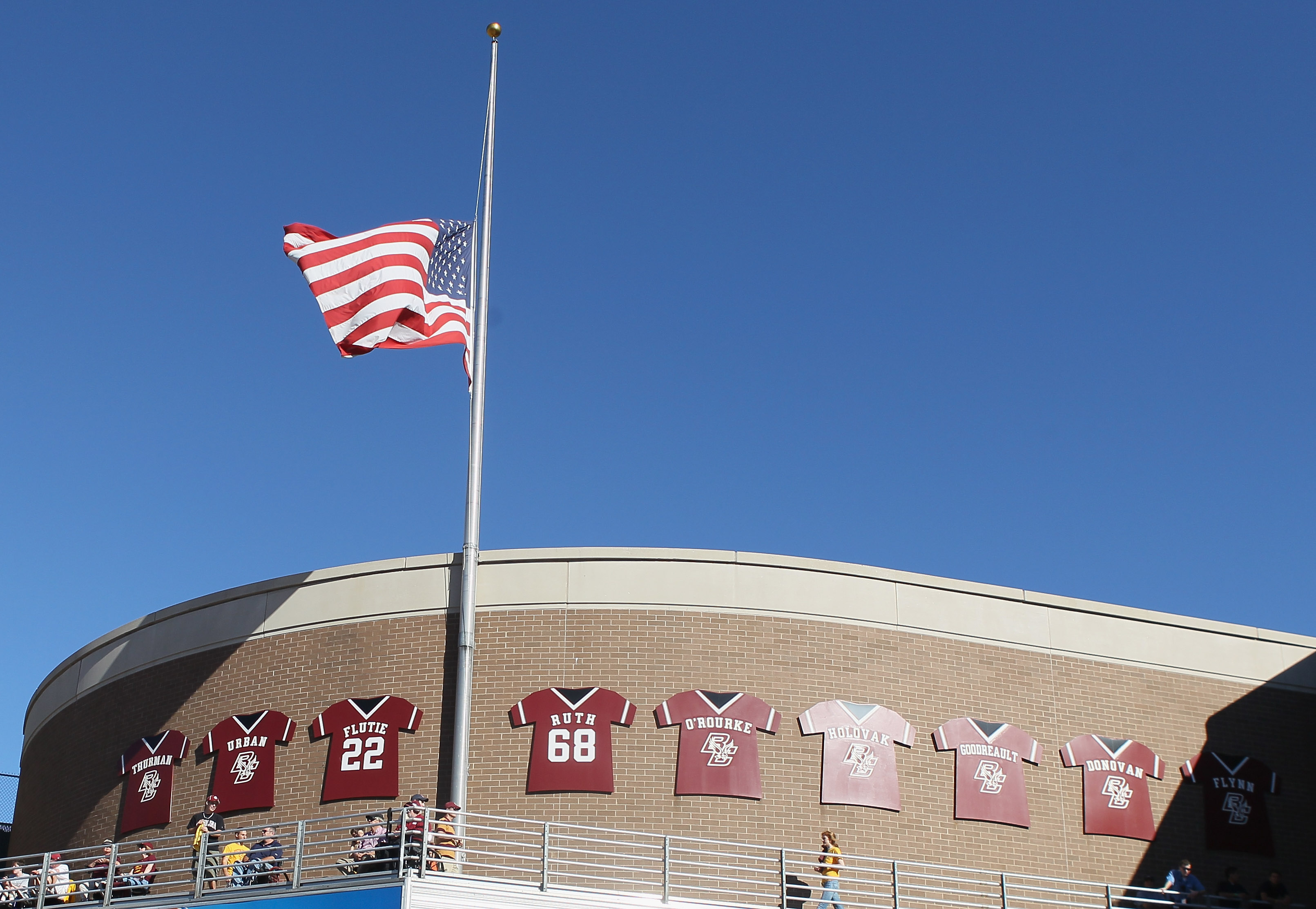 CHESTNUT HILL, MA - SEPTEMBER 11:  The flag is raised to  half staff in honor of the 9/11 attacks during the game between the Boston College Eagles and the Kent State Golden Flashes on September 11, 2010 at Alumni Stadium in Chestnut Hill, Massachusetts.