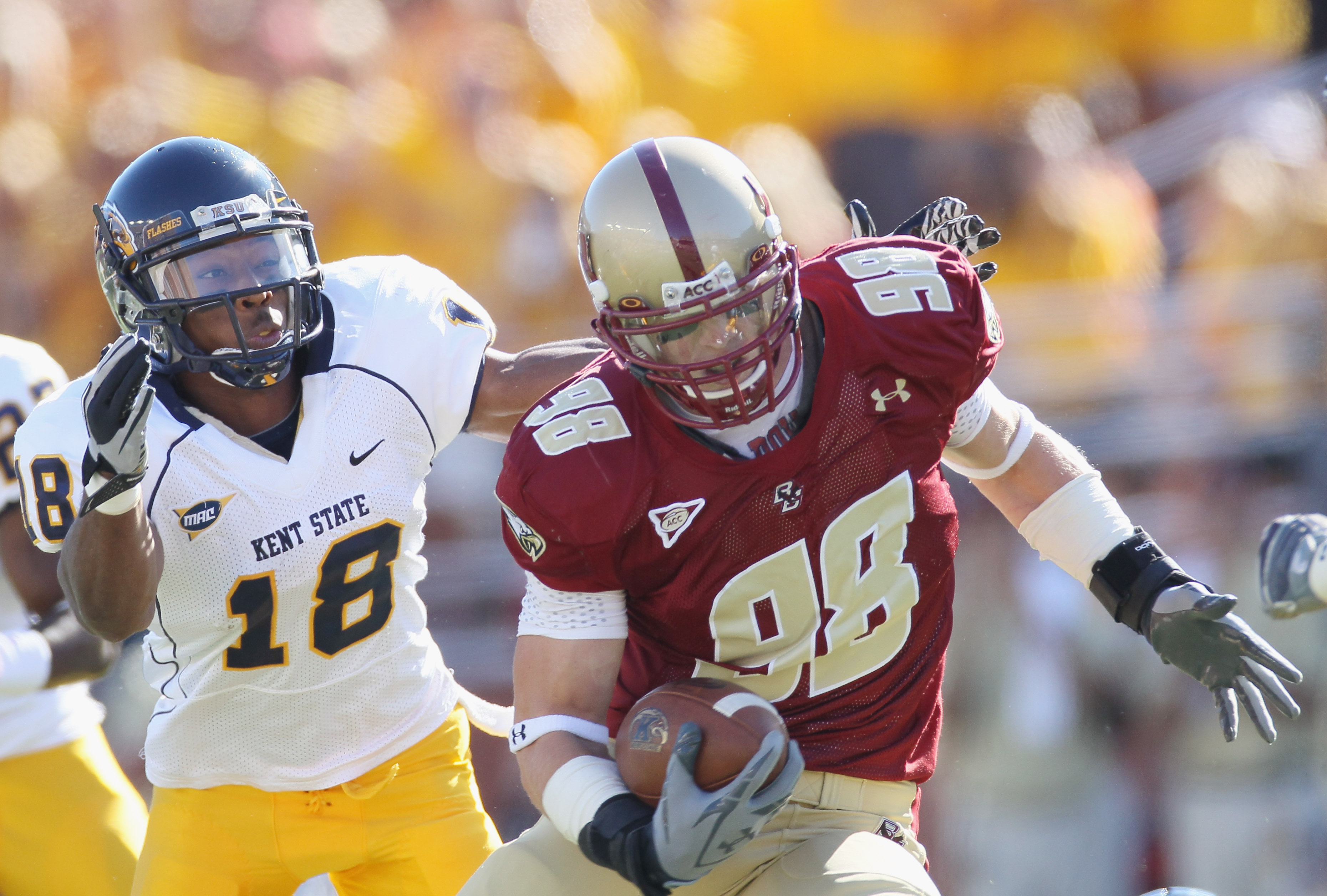 CHESTNUT HILL, MA - SEPTEMBER 11:  Alex Albright #98 of the Boston College Eagles carries the ball after he intercepted a pass as Sam Kirkland #18 of the Kent State Golden Flashes defends on September 11, 2010 at Alumni Stadium in Chestnut Hill, Massachus