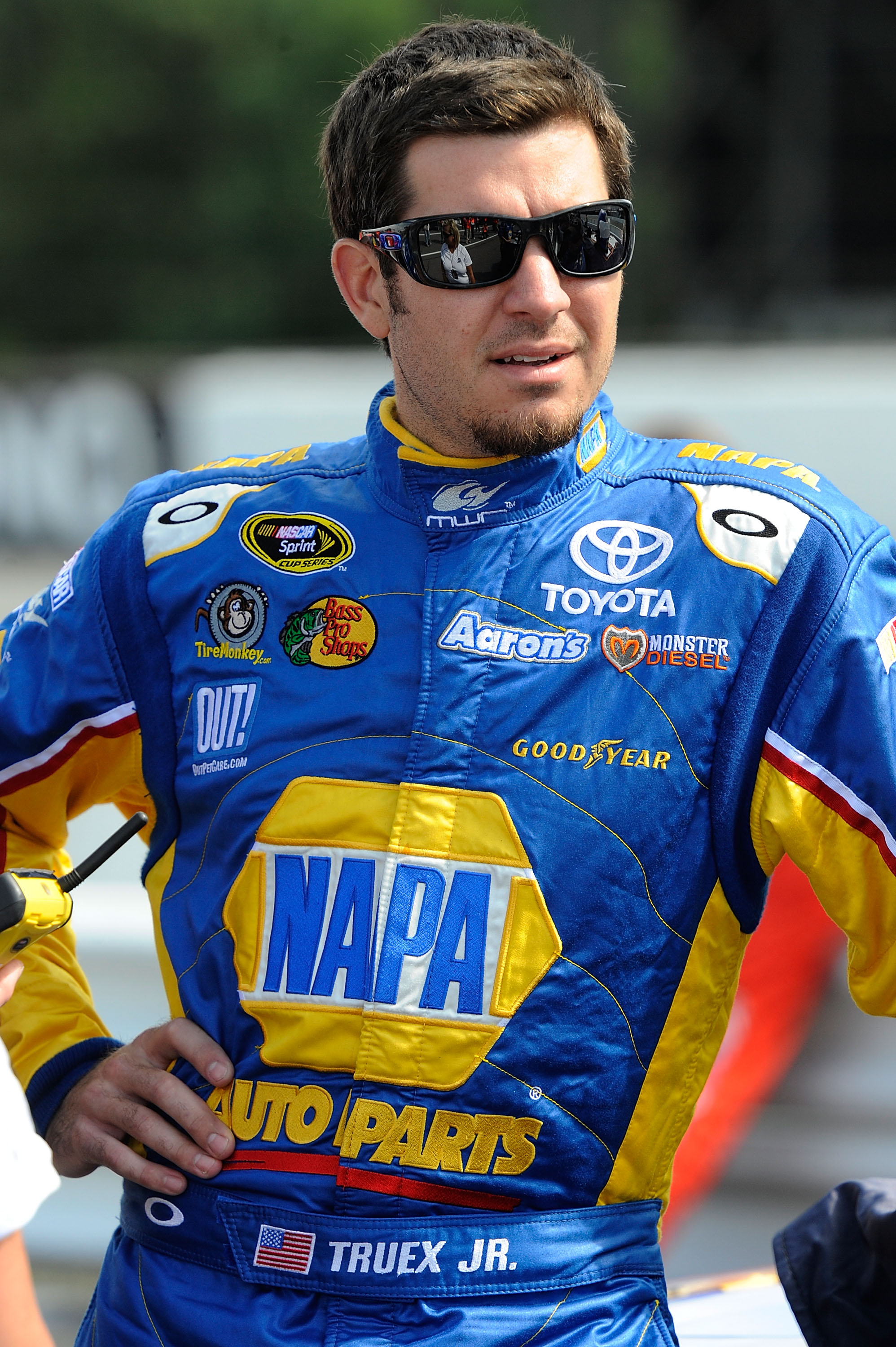 LONG POND, PA - JULY 30:  Martin Truex Jr., driver of the #56 NAPA Auto Parts Toyota, stands on the grid during qualifying for the NASCAR Sprint Cup Series Sunoco Red Cross Pennsylvania 500 at Pocono Raceway on July 30, 2010 in Long Pond, Pennsylvania.  (