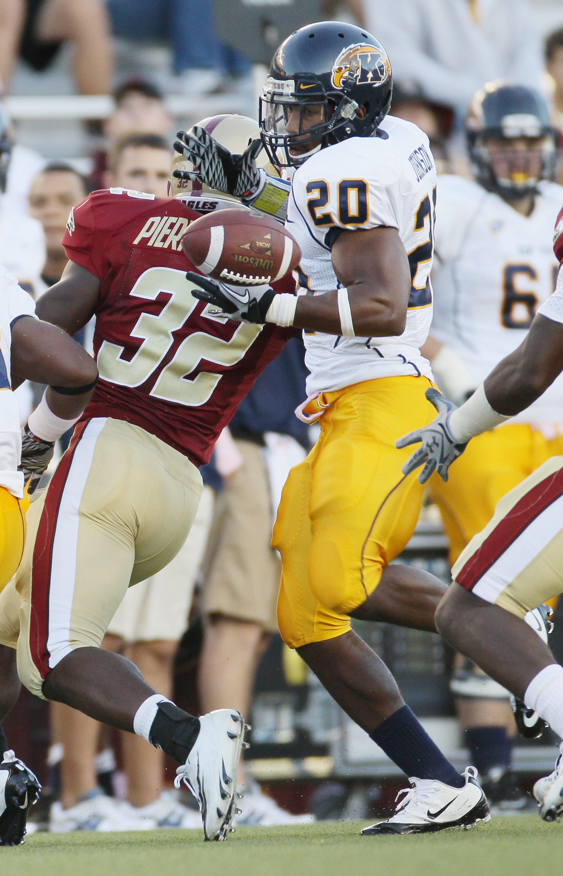 CHESTNUT HILL, MA - SEPTEMBER 11:  Will Johnson #20 of the Kent State Golden Flashes cannot hang on to teammate Leneric Muldrow's fumble as Kevin Pierre-Lewis #32 of the Boston College Eagles defends on September 11, 2010 at Alumni Stadium in Chestnut Hil