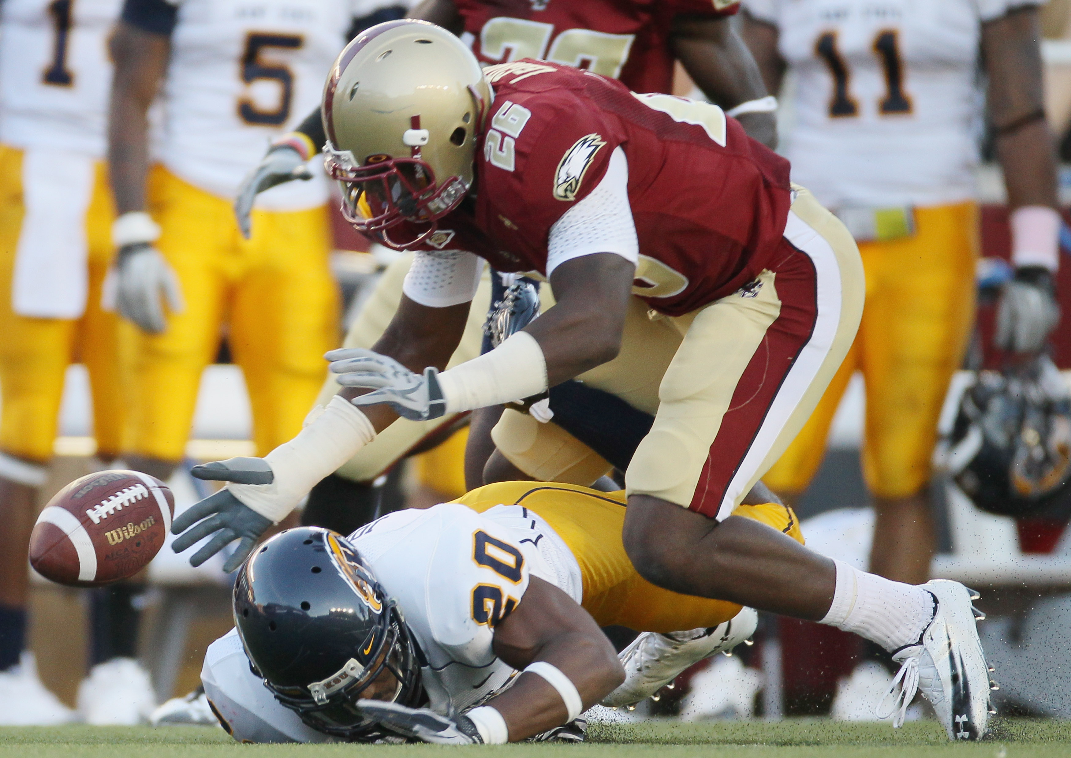 CHESTNUT HILL, MA - SEPTEMBER 11:  Dominick LeGrande #26 of the Boston College Eagles and Will Johnson #20 of the Kent State Golden Flashes chase after the fumble on September 11, 2010 at Alumni Stadium in Chestnut Hill, Massachusetts. Boston College defe