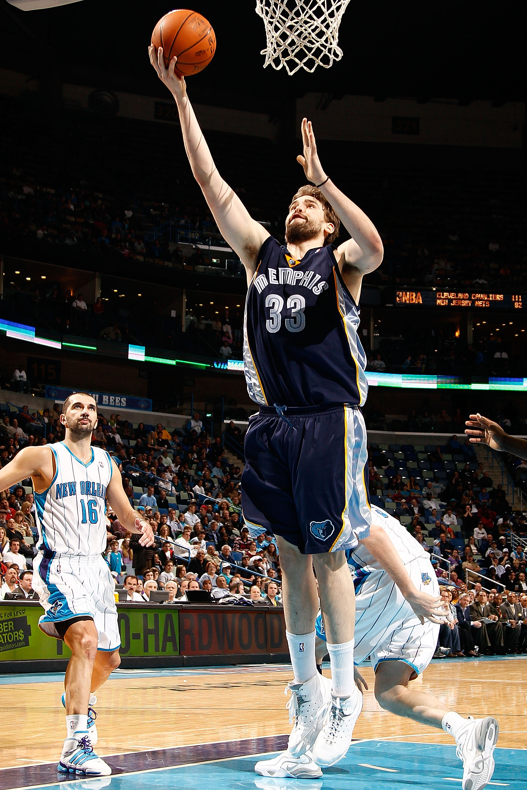 NEW ORLEANS - MARCH 03:  Marc Gasol #33of the Memphis Grizzlies shoots the ball around Peja Stojakovic #16 of the New Orleans Hornets at the New Orleans Arena on March 3, 2010 in New Orleans, Louisiana.  The Grizzlies defeated the Hornets 104-100.  NOTE T
